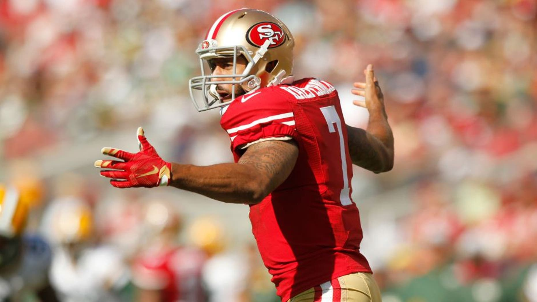 Oct 4, 2015; Santa Clara, CA, USA; San Francisco 49ers quarterback Colin Kaepernick (7) reacts after being hit on a 49ers running play against the Green Bay Packers in the third quarter at Levi's Stadium. The Packers defeated the 49ers 17-3. Mandatory Credit: Cary Edmondson-USA TODAY Sports