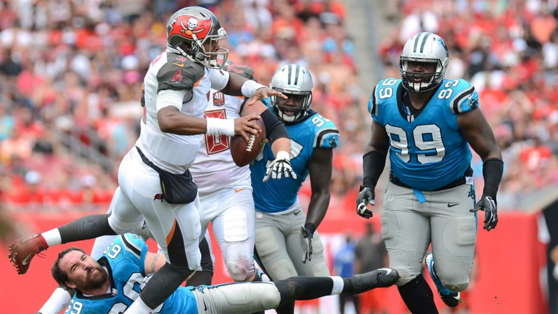 Oct 4, 2015; Tampa, FL, USA; Tampa Bay Buccaneers quarterback Jameis Winston (3) runs with the ball in the first half against the Carolina Panthers at Raymond James Stadium. Mandatory Credit: Jonathan Dyer-USA TODAY Sports