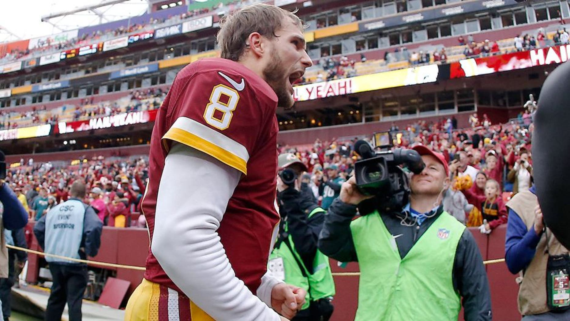 Oct 4, 2015; Landover, MD, USA; Washington Redskins quarterback Kirk Cousins (8) celebrates while leaving the field after the Reskins' game against the Philadelphia Eagles at FedEx Field. The Redskins won 23-20. Mandatory Credit: Geoff Burke-USA TODAY Sports