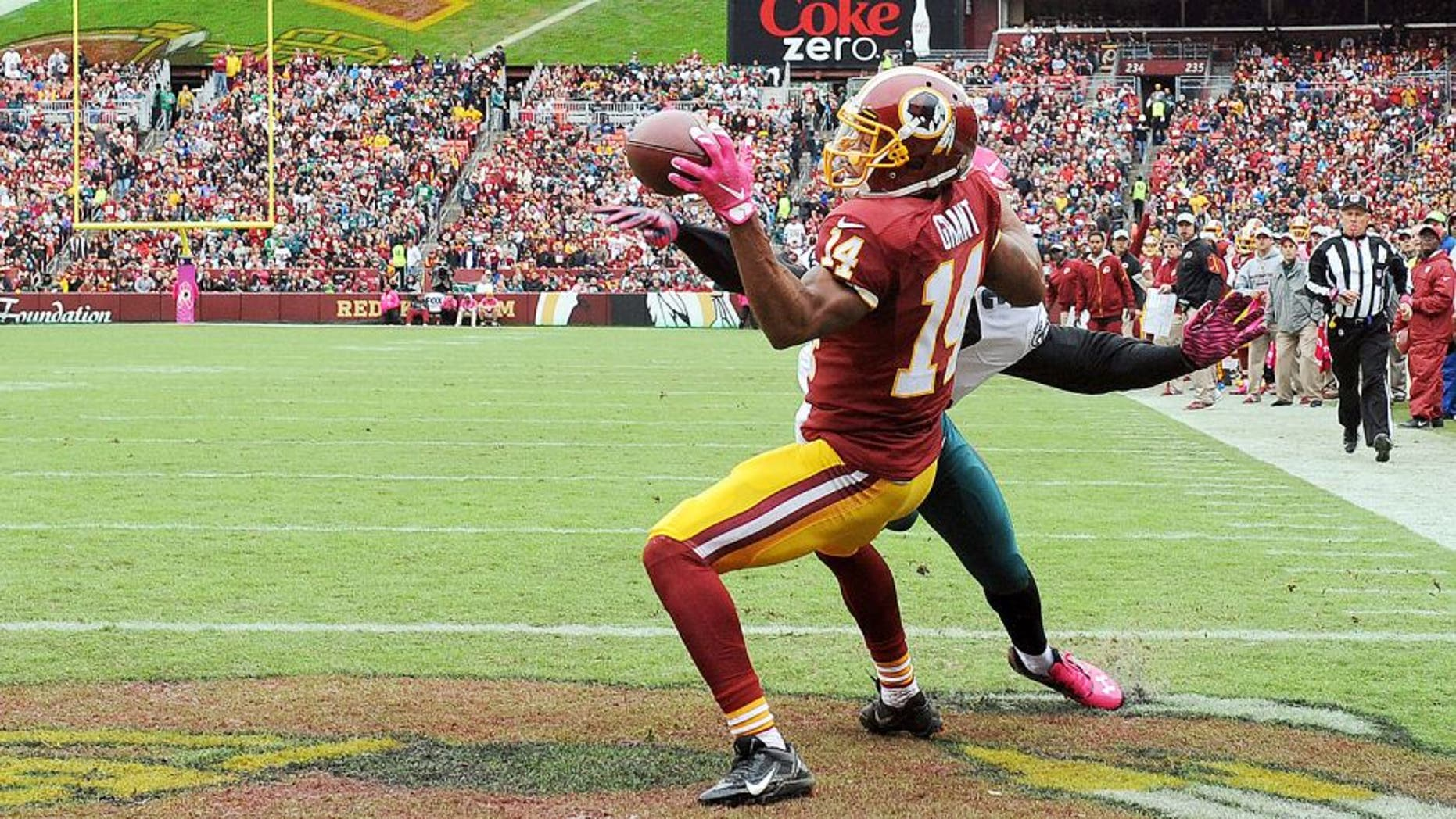 Oct 4, 2015; Landover, MD, USA; Washington Redskins wide receiver Ryan Grant (14) is interfered with by Philadelphia Eagles cornerback Eric Rowe (32) during the first half at FedEx Field. Mandatory Credit: Brad Mills-USA TODAY Sports