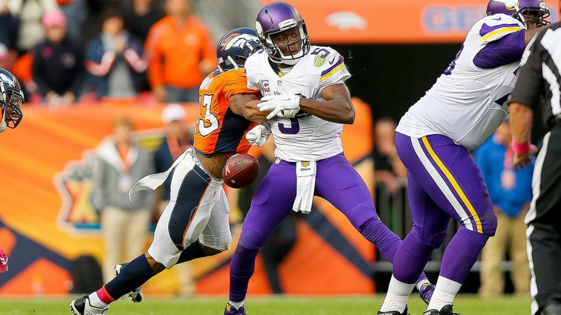 DENVER, CO - OCTOBER 4: Quarterback Teddy Bridgewater #5 of the Minnesota Vikings has the ball stripped by strong safety T.J. Ward #43 of the Denver Broncos to end the game in favor of the Denver Broncos by a score of 23-20 at Sports Authority Field at Mile High on October 4, 2015 in Denver, Colorado. (Photo by Justin Edmonds/Getty Images)
