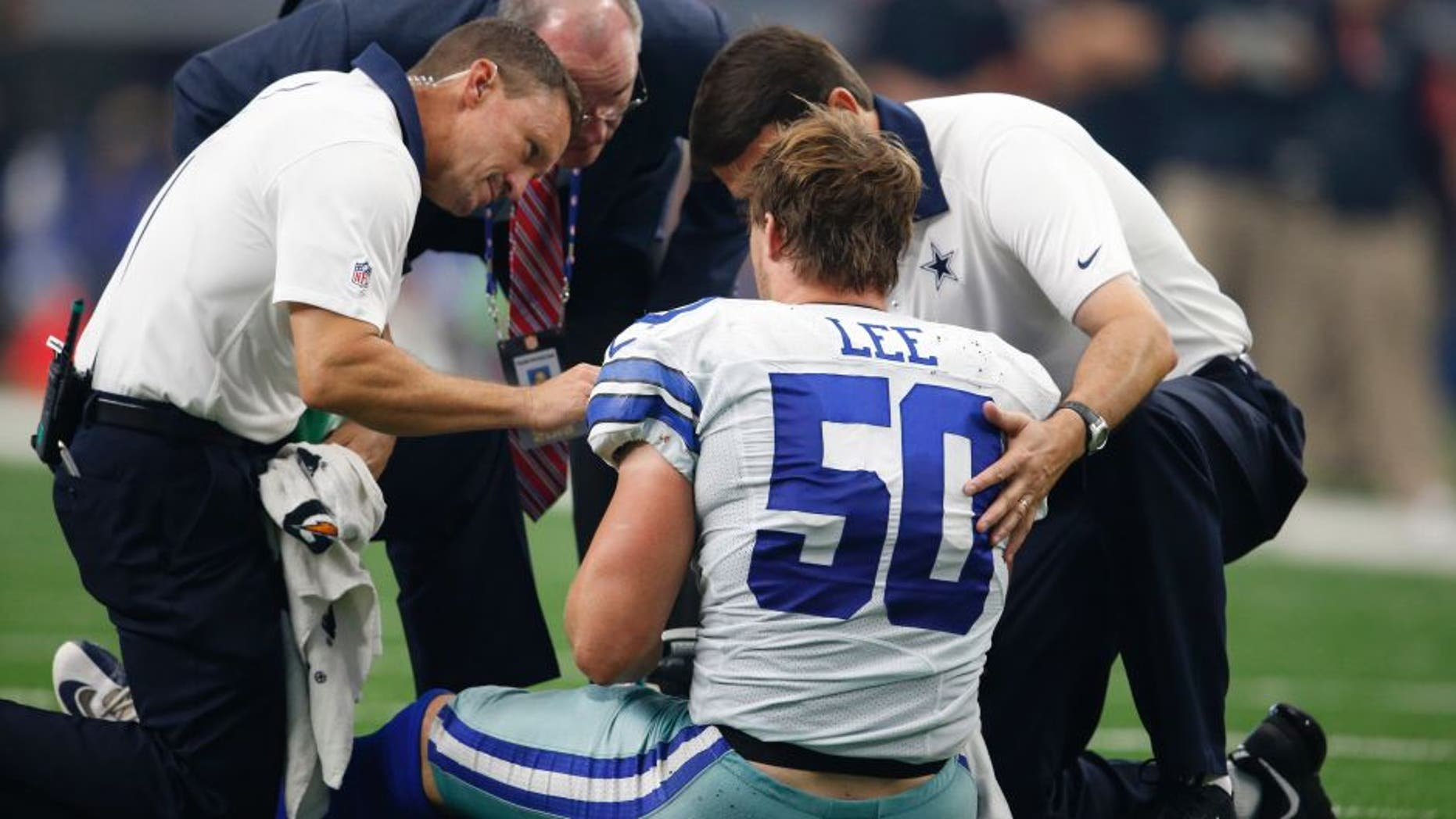 Sep 27, 2015; Arlington, TX, USA; Dallas Cowboys linebacker Sean Lee (50) is attended to after an injury in the third quarter against the Atlanta Falcons at AT&T Stadium. Mandatory Credit: Matthew Emmons-USA TODAY Sports