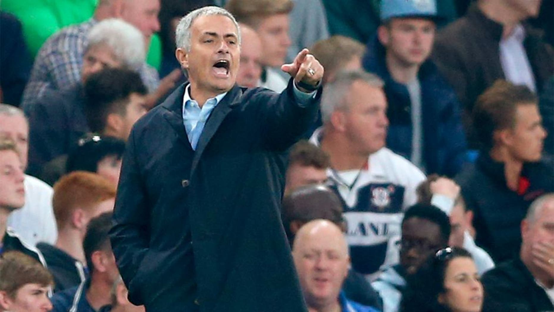 Chelsea's Portuguese manager Jose Mourinho gestures during the English Premier League football match between Chelsea and Southampton at Stamford Bridge in London on October 3, 2015. AFP PHOTO / JUSTIN TALLIS RESTRICTED TO EDITORIAL USE. No use with unauthorized audio, video, data, fixture lists, club/league logos or 'live' services. Online in-match use limited to 75 images, no video emulation. No use in betting, games or single club/league/player publications. (Photo credit should read JUSTIN TALLIS/AFP/Getty Images)