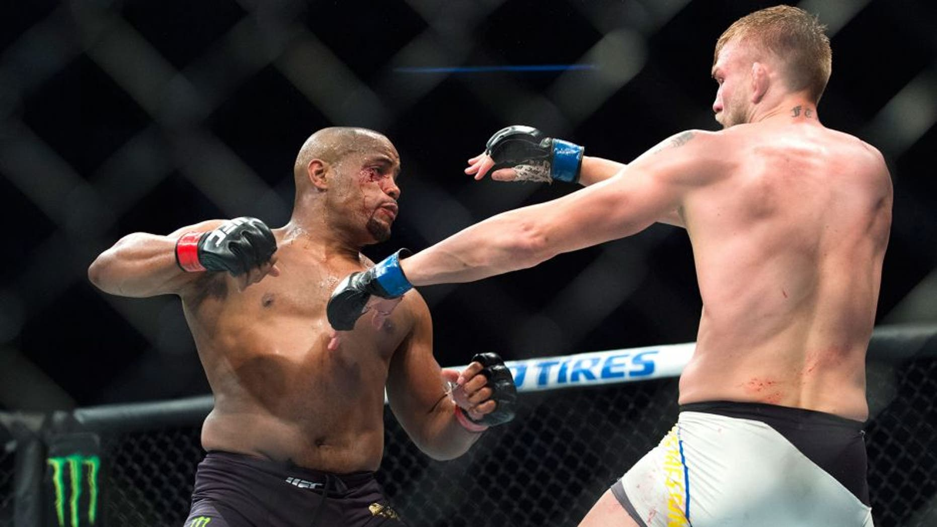 HOUSTON, TX - OCTOBER 3: Daniel Cormier throws a punch against Alexander Gustafsson during UFC 192 at the Toyota Center on October 3, 2015 in Houston, Texas. (Photo by Cooper Neill/Zuffa LLC/Zuffa LLC via Getty Images)