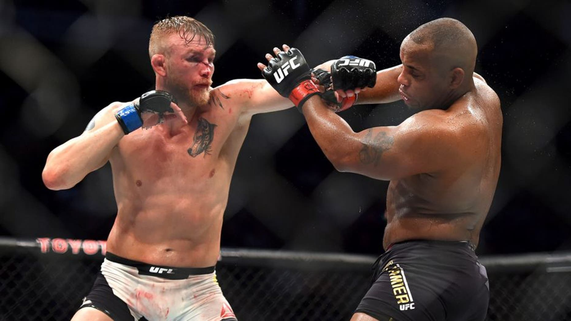 HOUSTON, TX - OCTOBER 03: (L-R) Alexander Gustafsson punches Daniel Cormier in their UFC light heavyweight championship bout during the UFC 192 event at the Toyota Center on October 3, 2015 in Houston, Texas. (Photo by Jeff Bottari/Zuffa LLC/Zuffa LLC via Getty Images)