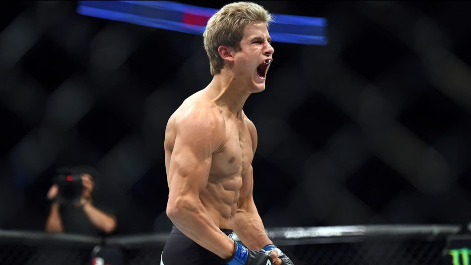 HOUSTON, TX - OCTOBER 03: Sage Northcutt celebrates after defeating Francisco Trevino in their lightweight bout during the UFC 192 event at the Toyota Center on October 3, 2015 in Houston, Texas. (Photo by Jeff Bottari/Zuffa LLC/Zuffa LLC via Getty Images)