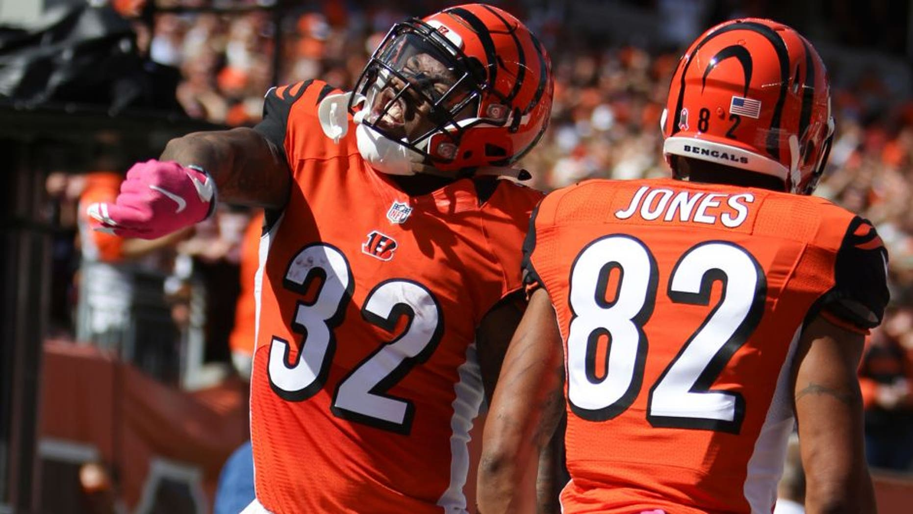 Cincinnati Bengals running back Jeremy Hill (32) celebrates after scoring a touchdown in the first half of a NFL football game against the Kansas City Chiefs, Sunday, Oct. 4, 2015, in Cincinnati. (AP Photo/Frank Victores)