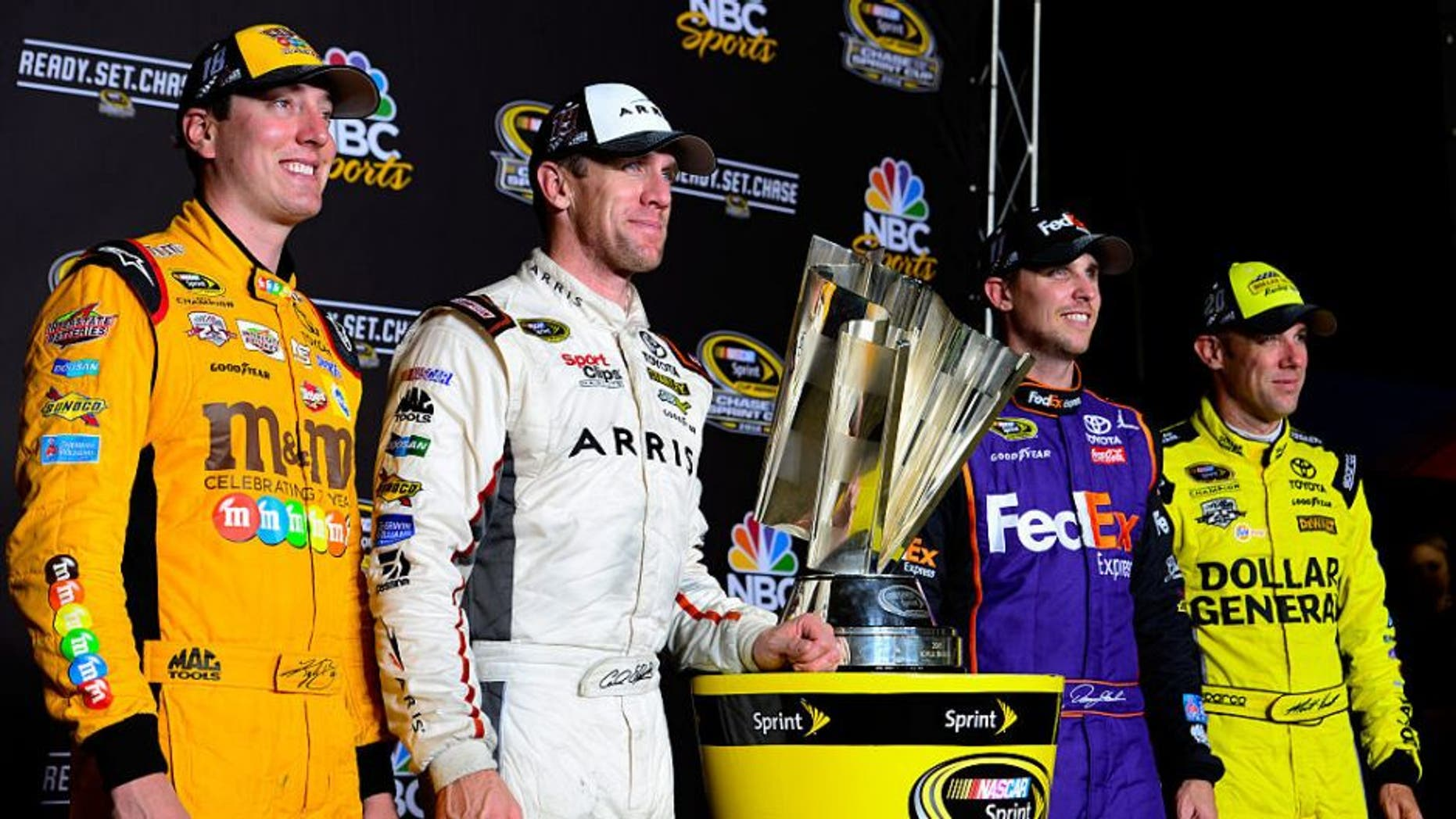 RICHMOND, VA - SEPTEMBER 10: Kyle Busch, driver of the #18 M&M's 75th Anniversary Toyota, Carl Edwards, driver of the #19 ARRIS Surfboard Toyota, Denny Hamlin, driver of the #11 FedEx Ground Toyota, and Matt Kenseth, driver of the #20 Dollar General Toyota, pose with the NASCAR Sprint Cup trophy after the NASCAR Sprint Cup Series Federated Auto Parts 400 at Richmond International Raceway on September 10, 2016 in Richmond, Virginia. (Photo by Robert Laberge/Getty Images)