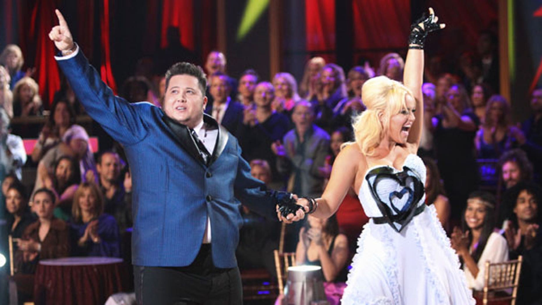 "Sept. 26: In this image released by ABC, Chaz Bono, left, and his partner Lacey Schwimmer perform on the celebrity dance competition series, ""Dancing with the Stars,"" in Los Angeles."
