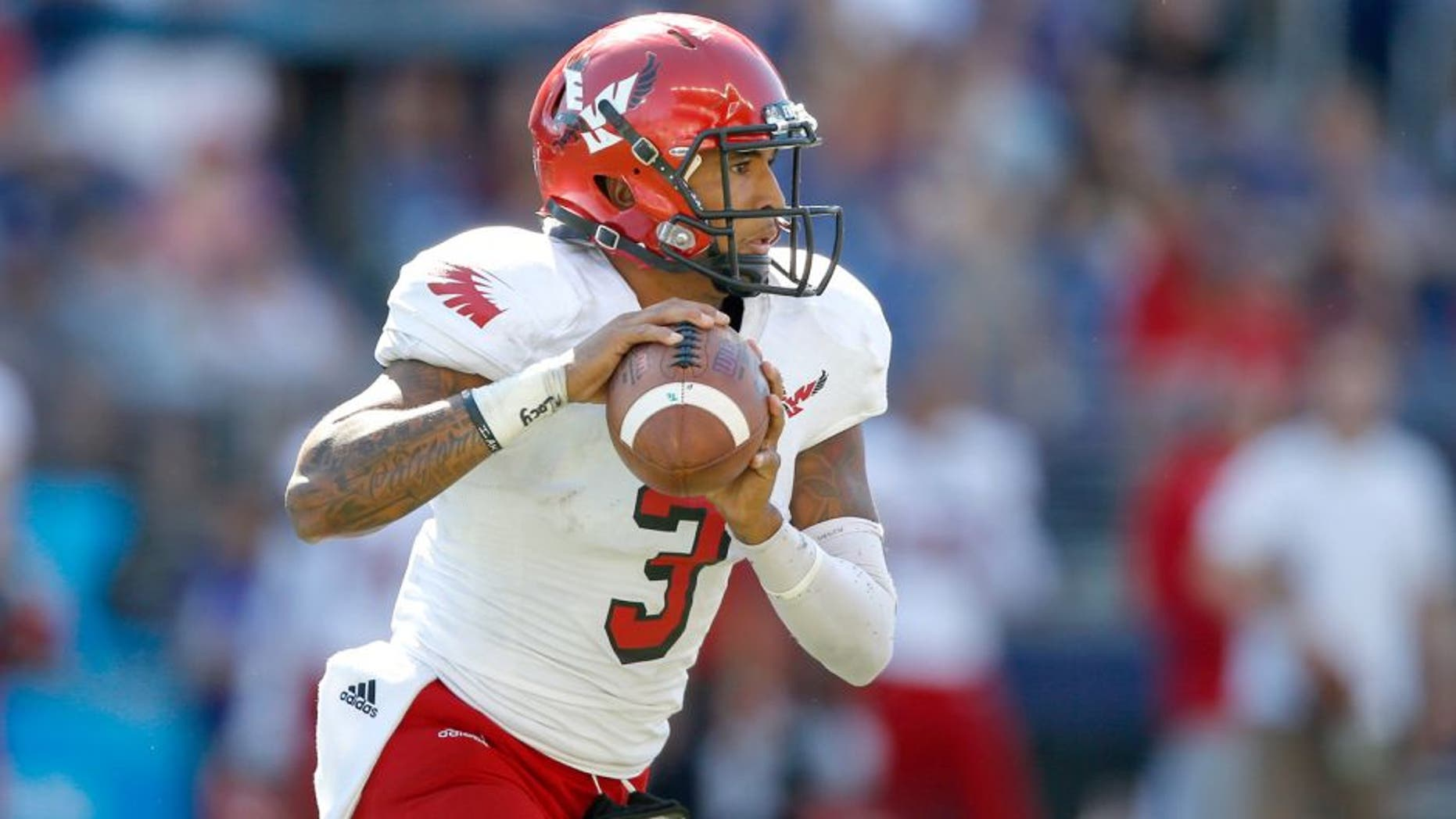 SEATTLE, WA - SEPTEMBER 06: Quarterback Vernon Adams Jr. #3 of the Eastern Washington Eagles looks downfield to pass against the Washington Huskies on September 6, 2014 at Husky Stadium in Seattle, Washington. (Photo by Otto Greule Jr/Getty Images)