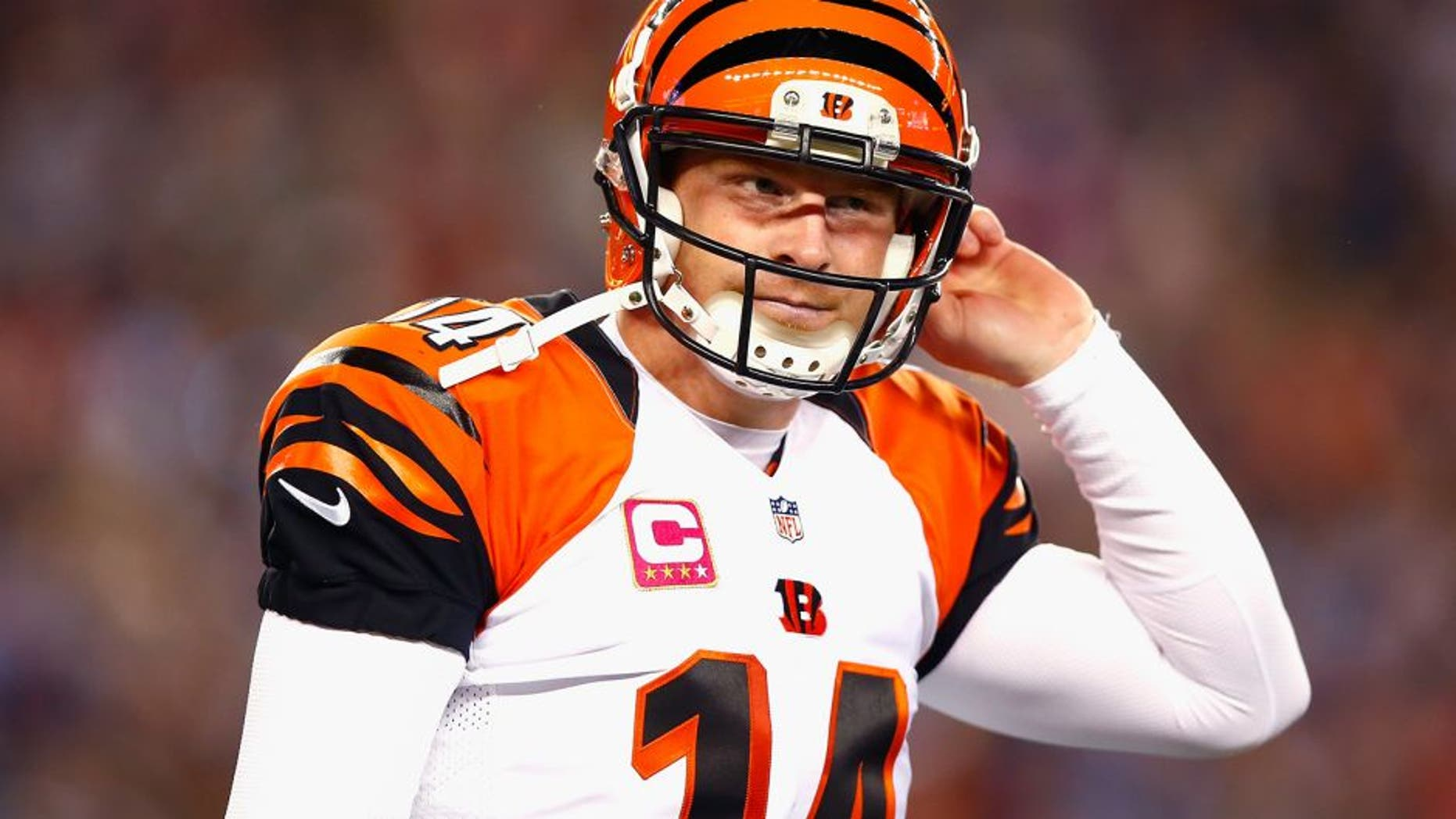 FOXBORO, MA - OCTOBER 05: Andy Dalton #14 of the Cincinnati Bengals reacts during the second quarter against the New England Patriots at Gillette Stadium on October 5, 2014 in Foxboro, Massachusetts. (Photo by Jared Wickerham/Getty Images)