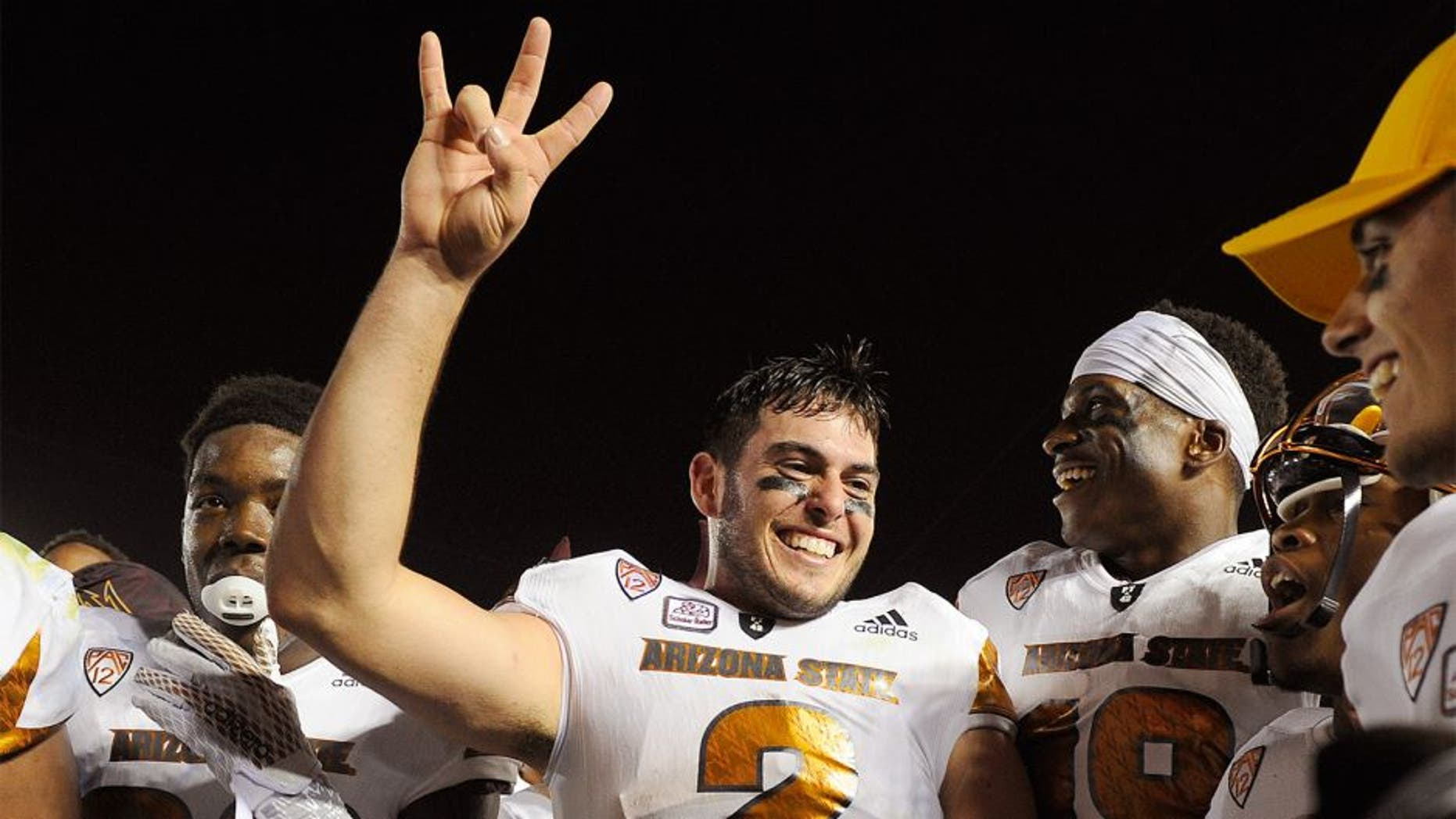 PASADENA, CA - OCTOBER 3: Quarterback Mike Bercovici #2 of the Arizona State Sun Devils and teammate celebrate the upset win over UCLA Bruins, 38-23, at the Rose Bowl October 3, 2015, in Pasadena, California. (Photo by Kevork Djansezian/Getty Images)
