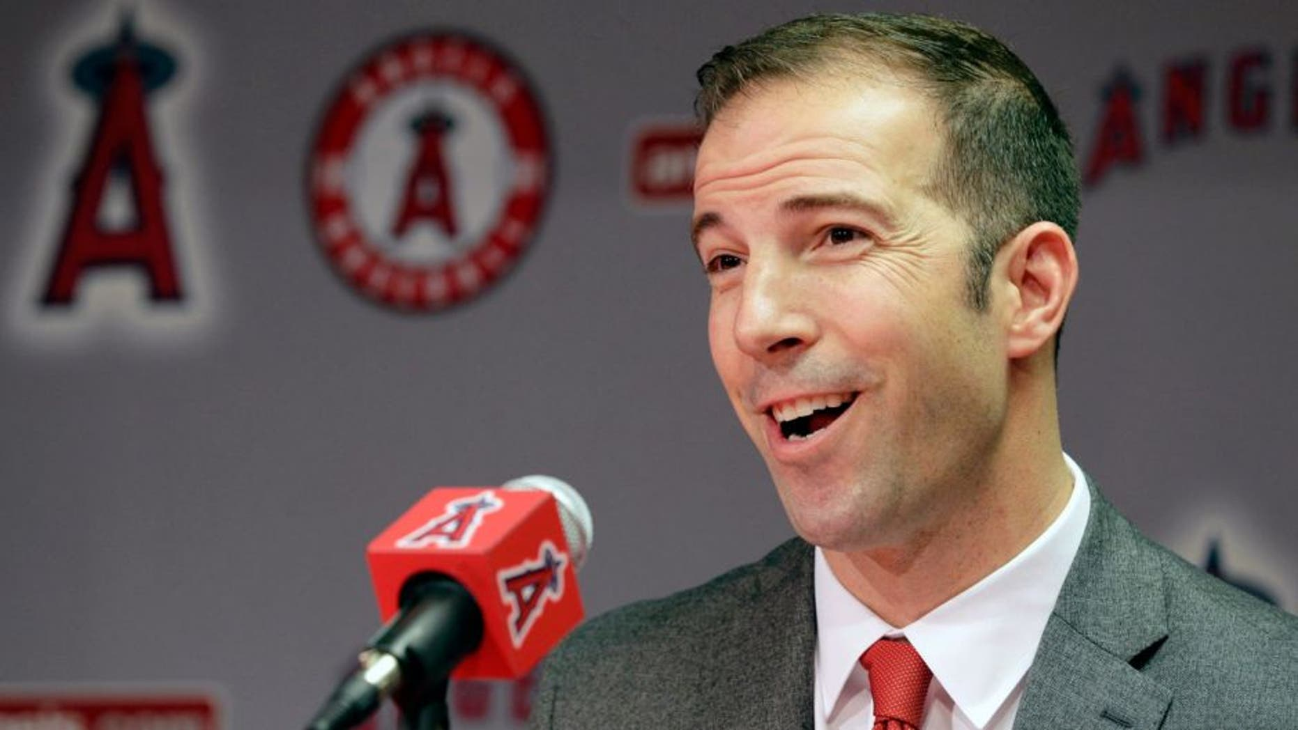 Longtime Yankees executive Billy Eppler smiles during a news conference announcing him as the new general manager for the Los Angeles Angels in Anaheim, Calif., Monday, Oct. 5, 2015. The 40-year-old Eppler replaces interim GM Bill Stoneman, who took over after Jerry Dipoto quit his job at midseason following his latest disagreement with Mike Scioscia, the longest-serving manager in baseball. (AP Photo/Nick Ut)