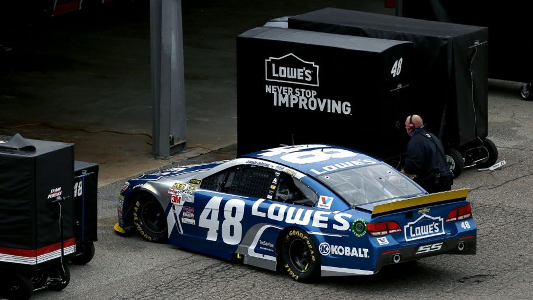 DOVER, DE - OCTOBER 04: Jimmie Johnson, driver of the #48 Lowe's Chevrolet, drives into his garage during the NASCAR Sprint Cup Series AAA 400 at Dover International Speedway on October 4, 2015 in Dover, Delaware. (Photo by Patrick Smith/Getty Images)