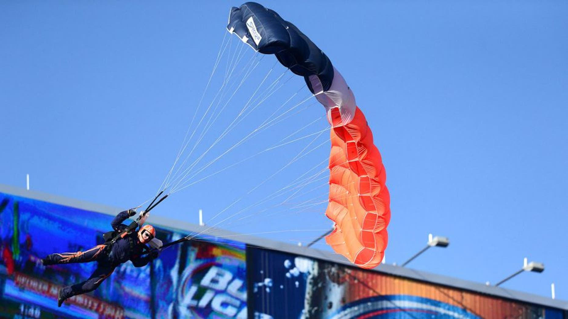 Dec 8, 2013; Denver, CO, USA; General view of a sky diver performer coming into Sports Authority Field at Mile High.before the game Tennessee Titans against the Denver Broncos. Mandatory Credit: Ron Chenoy-USA TODAY Sports