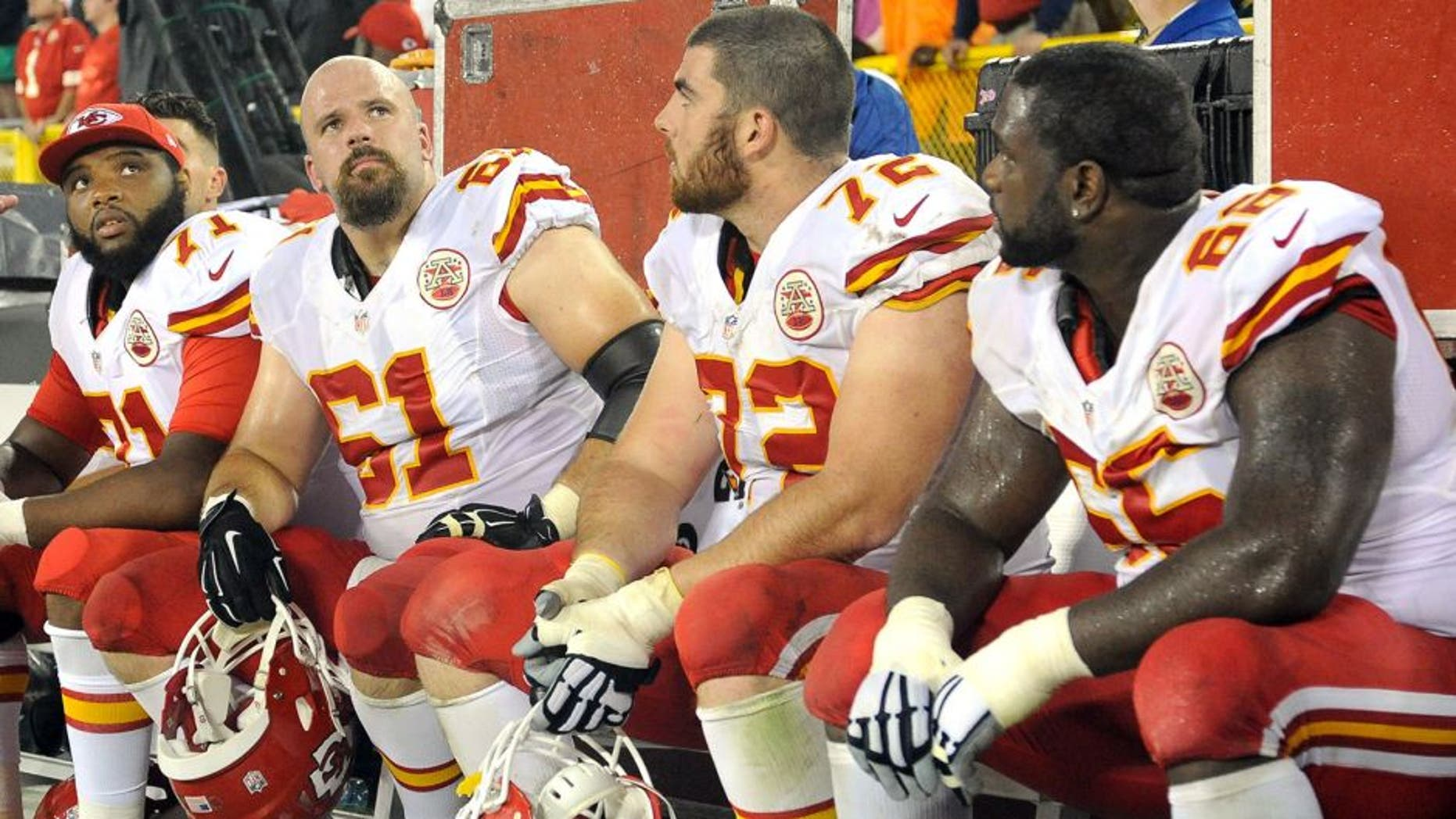 Sep 28, 2015; Green Bay, WI, USA; Kansas City Chiefs offensive tackle Jeff Allen (71), center Mitch Morse (61), offensive tackle Eric Fisher (72) and guard Ben Grubbs (66) watch the final minutes of the game against the Green Bay Packers at Lambeau Field. Mandatory Credit: Benny Sieu-USA TODAY Sports