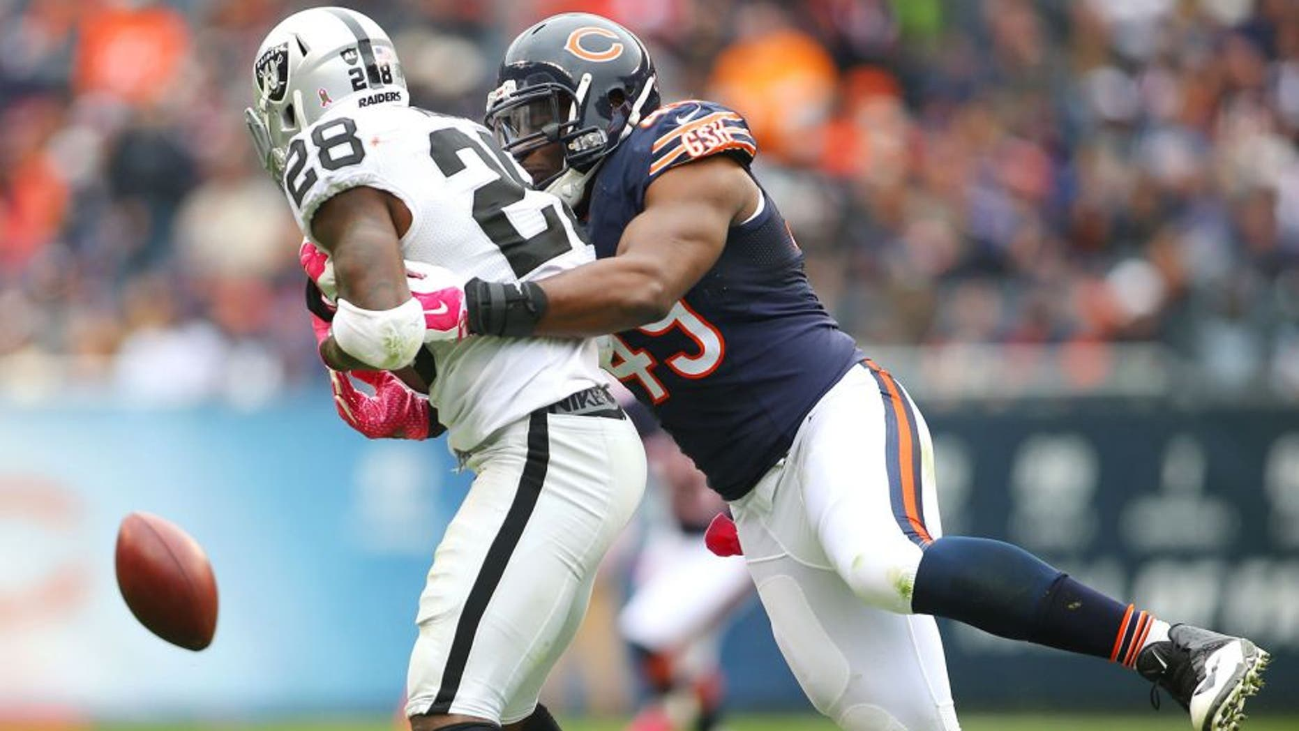 Oct 4, 2015; Chicago, IL, USA; Chicago Bears defensive end Sam Acho (49) breaks up a pass intended for Oakland Raiders running back Latavius Murray (28) during the second half at Soldier Field. Mandatory Credit: Jerry Lai-USA TODAY Sports