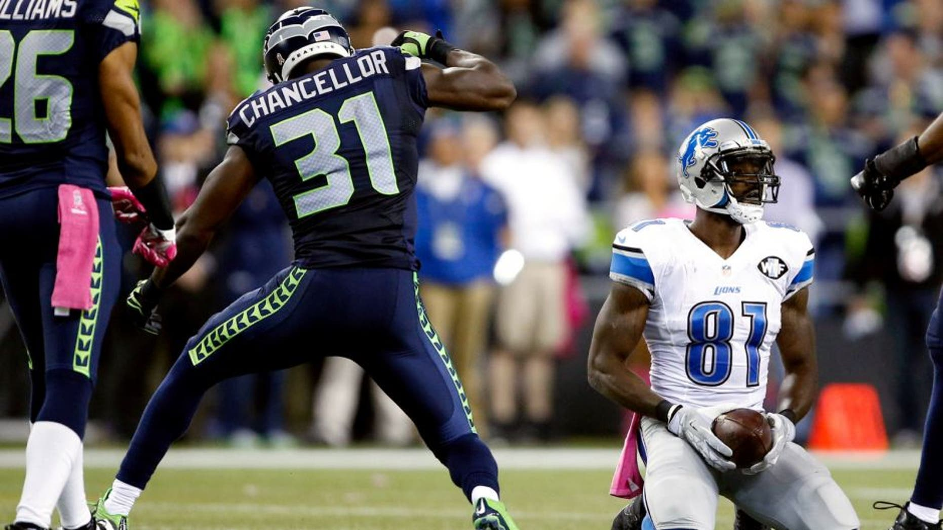 Oct 5, 2015; Seattle, WA, USA; Seattle Seahawks strong safety Kam Chancellor (31) reacts after his tackle against Detroit Lions wide receiver Calvin Johnson (81) during the fourth quarter at CenturyLink Field. Mandatory Credit: Joe Nicholson-USA TODAY Sports