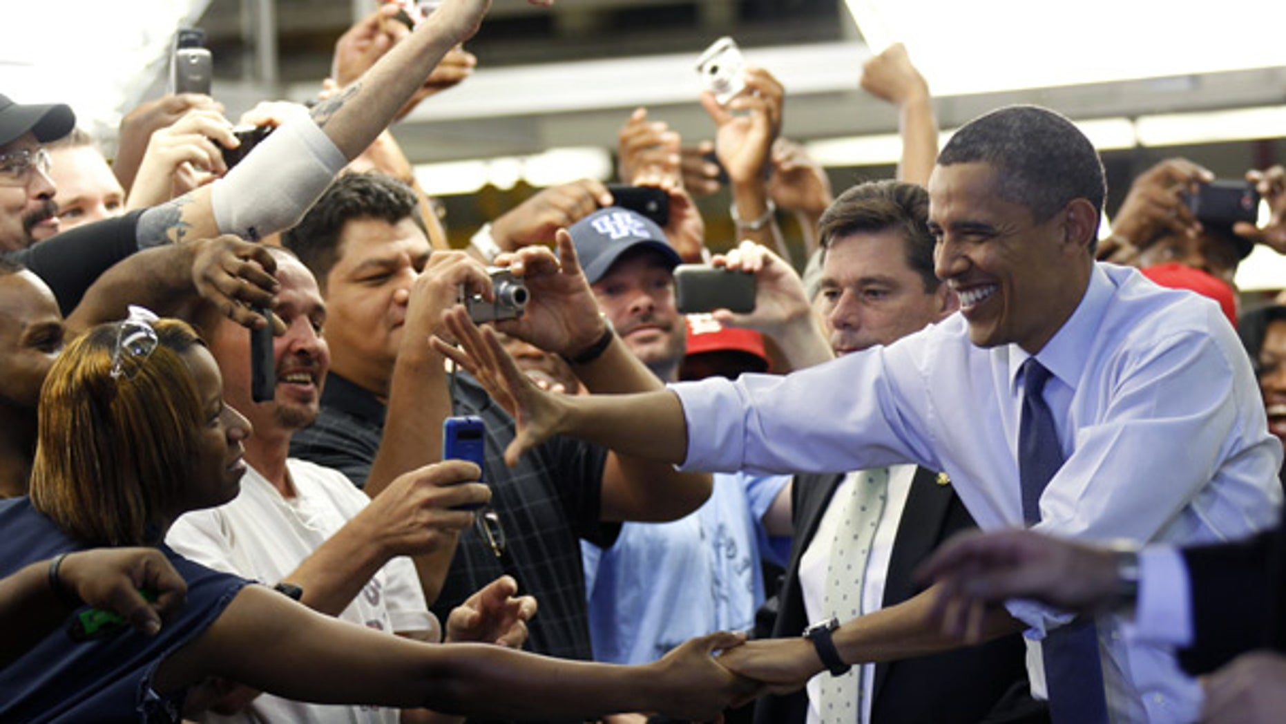 Aug. 5: President Barack Obama greets auto workers at Ford Motor Company Chicago Assembly Plant.