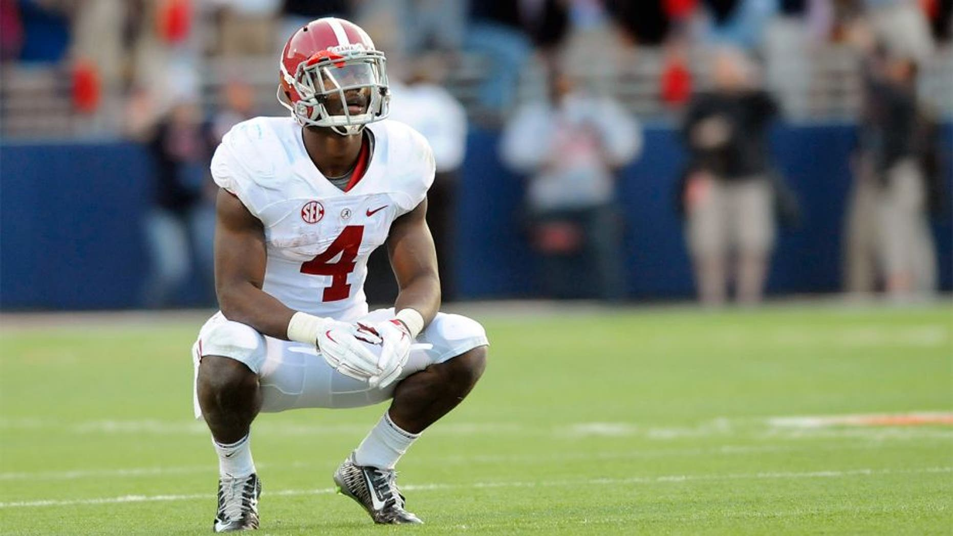 Oct 4, 2014; Oxford, MS, USA; Alabama Crimson Tide running back T.J. Yeldon (4) reacts while watching a replay of an interception in the end zone was overturned during the second half against the Mississippi Rebels at Vaught-Hemingway Stadium. The Rebels won 23-17. Mandatory Credit: Christopher Hanewinckel-USA TODAY Sports