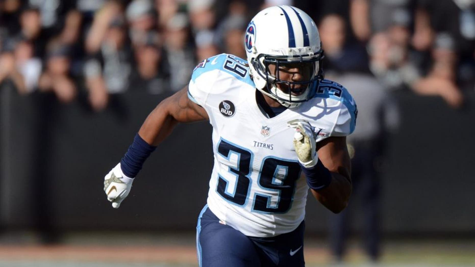 November 24, 2013; Oakland, CA, USA; Tennessee Titans strong safety Daimion Stafford (39) runs during the second quarter against the Oakland Raiders at O.co Coliseum. The Titans defeated the Raiders 23-19. Mandatory Credit: Kyle Terada-USA TODAY Sports
