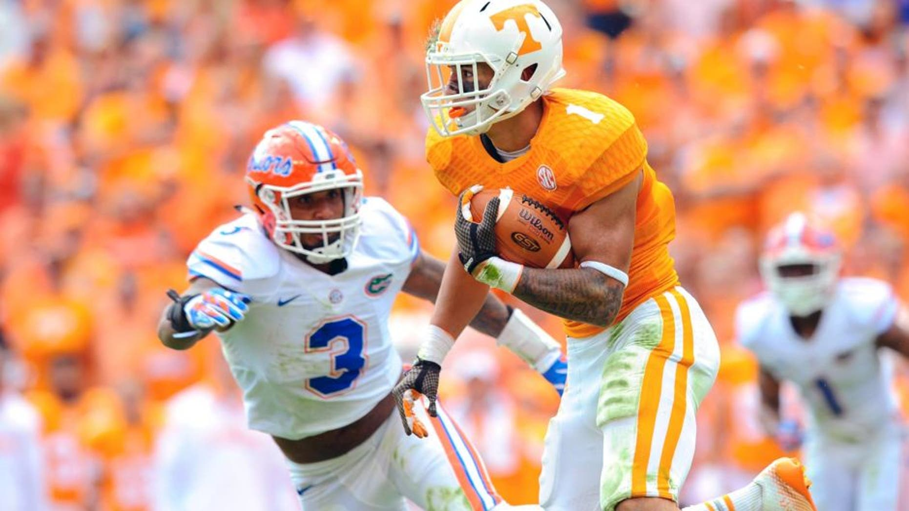 Oct 4, 2014; Knoxville, TN, USA; Tennessee Volunteers running back Jalen Hurd (1) runs the ball against the Florida Gators during the second quarter at Neyland Stadium. Mandatory Credit: Randy Sartin-USA TODAY Sports