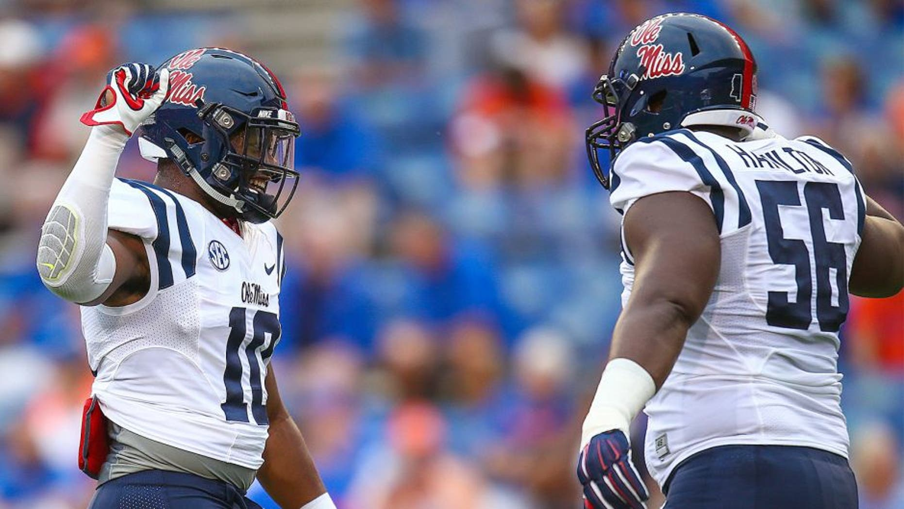 GAINESVILLE, FL - OCTOBER 03: C.J. Johnson #10 of the Mississippi Rebels slaps hands with Woodrow Hamilton #56 of the Mississippi Rebels before the game against the Florida Gators on October 3, 2015 in Gainesville, Florida. (Photo by Rob Foldy/Getty Images)