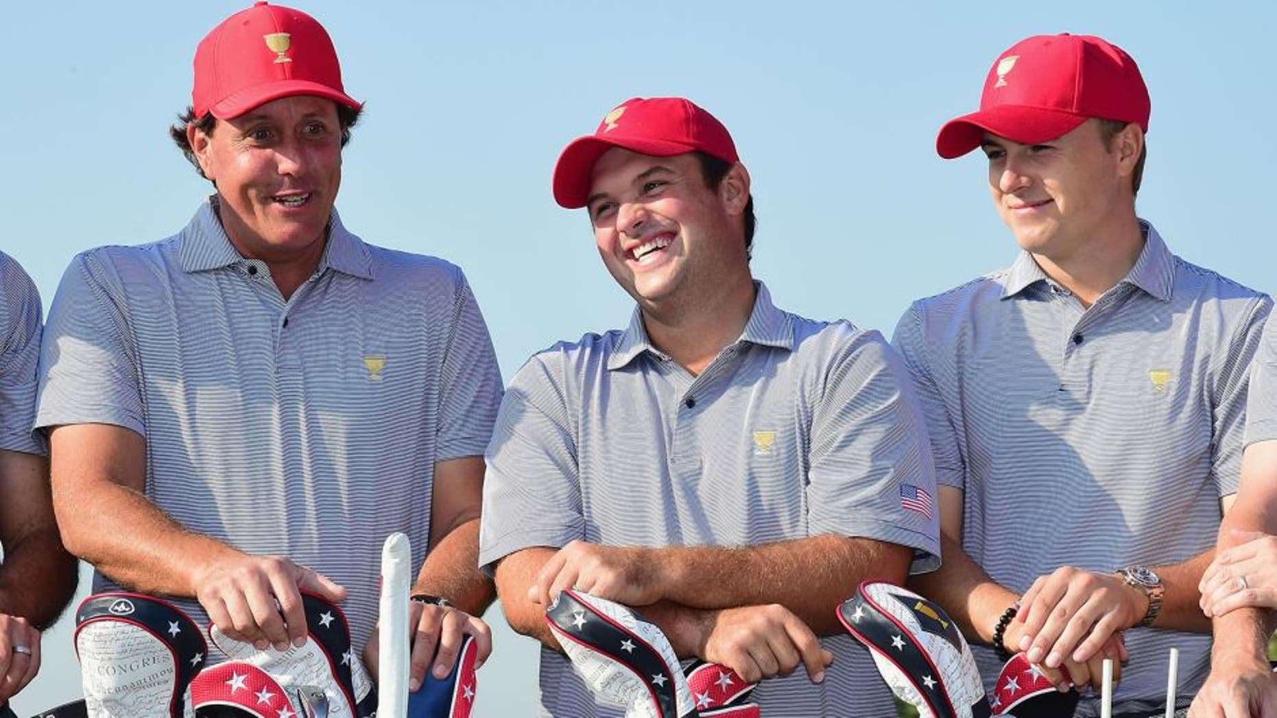 INCHEON CITY, SOUTH KOREA - OCTOBER 06: (L-R) Phil Mickelson, Patrick Reed and Jordan Spieth of the United States team pose with the team during a photocall on the practice ground prior to the start of The Presidents Cup at the Jack Nicklaus Golf Club on October 6, 2015 in Incheon City, South Korea. (Photo by Harry How/Getty Images)