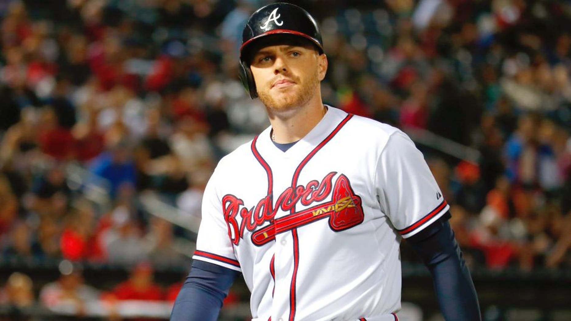 Freddie Freeman #5 of the Atlanta Braves reacts after flying out in the seventh inning against the Washington Nationals at Turner Field on October 1, 2015 in Atlanta, Georgia. (Photo by Kevin C. Cox/Getty Images)