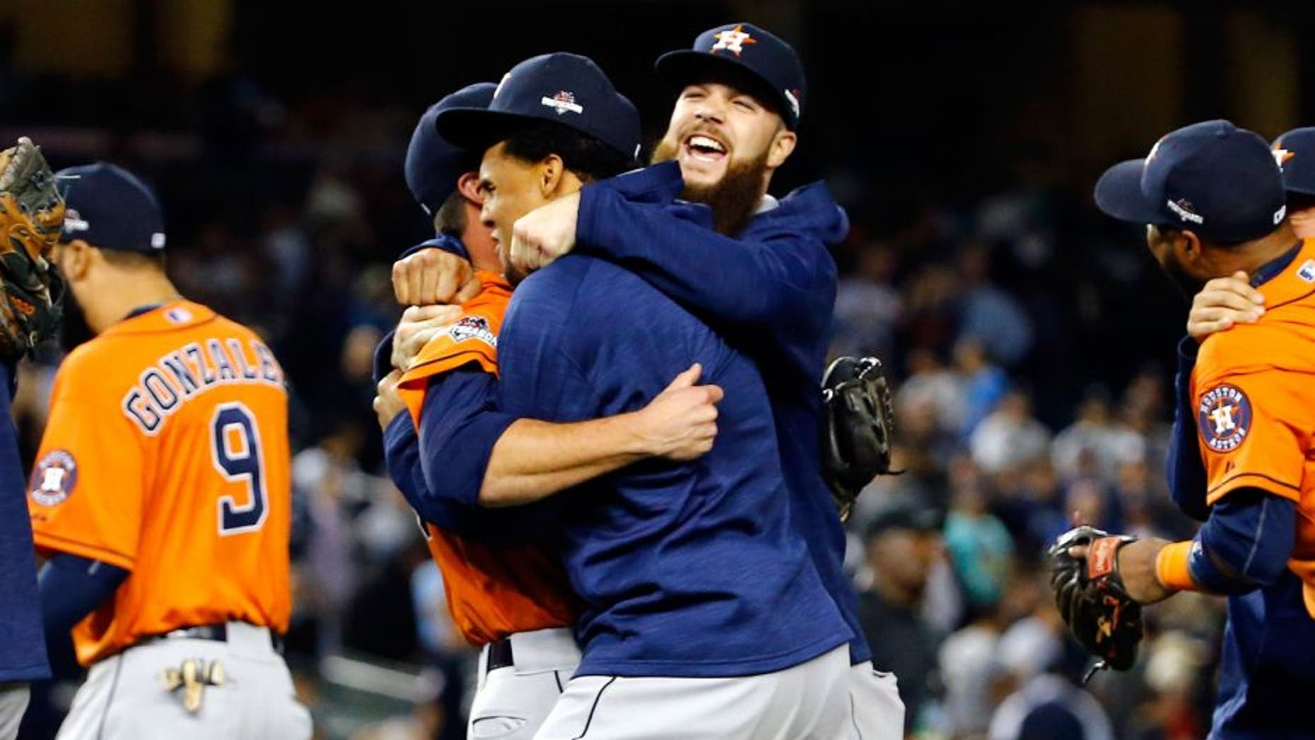 NEW YORK, NY - OCTOBER 06: The Houston Astros celebrate defeating the New York Yankees in the American League Wild Card Game at Yankee Stadium on October 6, 2015 in New York City. The Astros defeated the Yankees with a score of 3 to 0. (Photo by Al Bello/Getty Images)