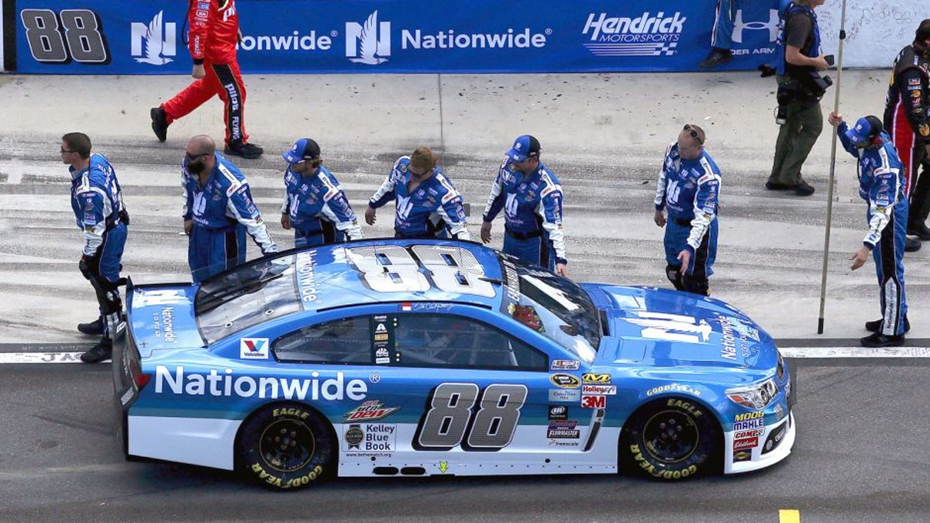 Dale Earnhardt Jr., driver of the #88 Nationwide Chevrolet, high-fives his crew on pit lane prior to the NASCAR Sprint Cup Series 57th Annual Daytona 500 at Daytona International Speedway on February 22, 2015 in Daytona Beach, Florida. (Photo by Sean Gardner/Getty Images)