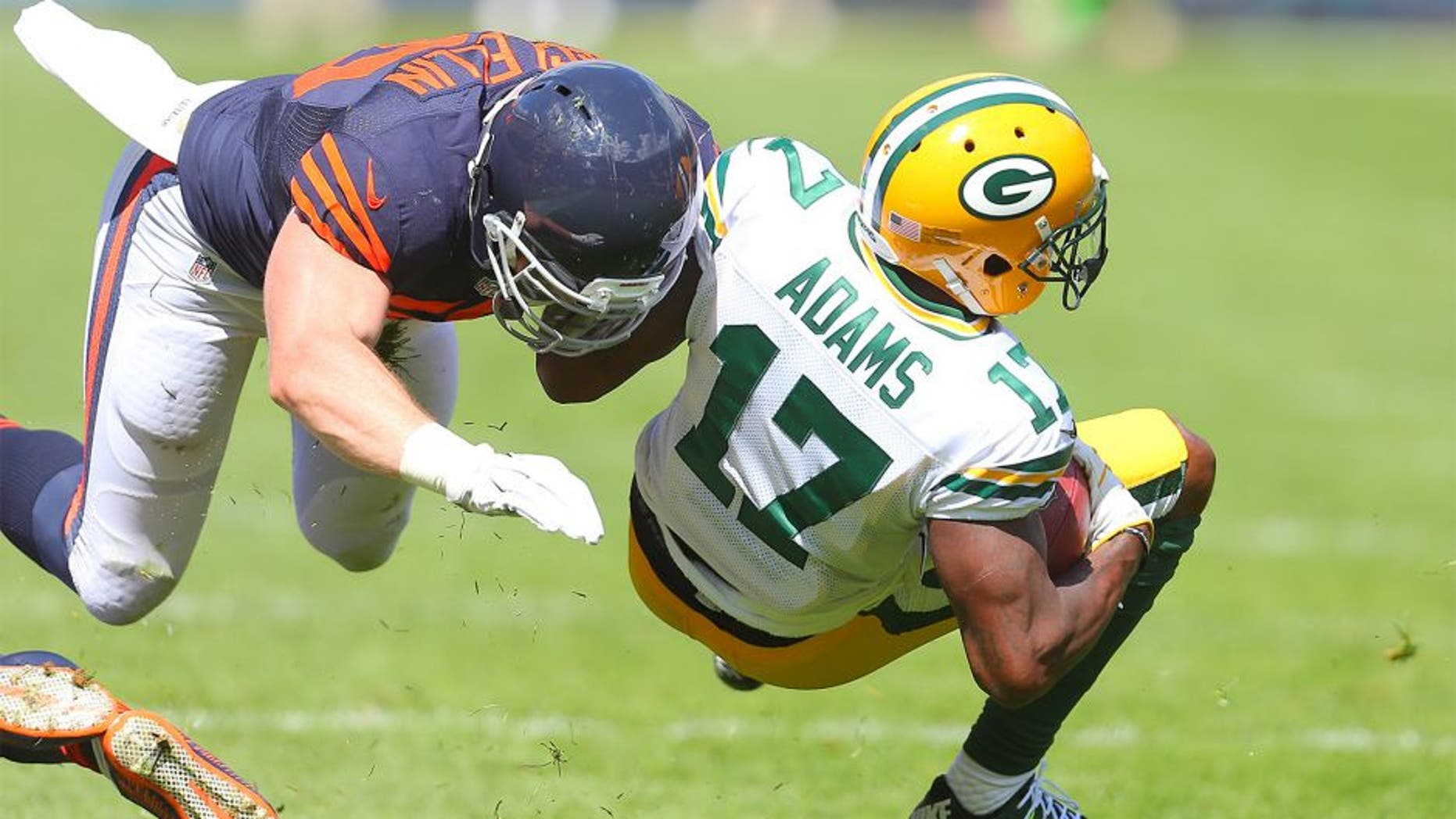 Sep 13, 2015; Chicago, IL, USA; Green Bay Packers wide receiver Davante Adams (17) is tackled by Chicago Bears outside linebacker Shea McClellin (50) during the second quarter at Soldier Field. Mandatory Credit: Dennis Wierzbicki-USA TODAY Sports