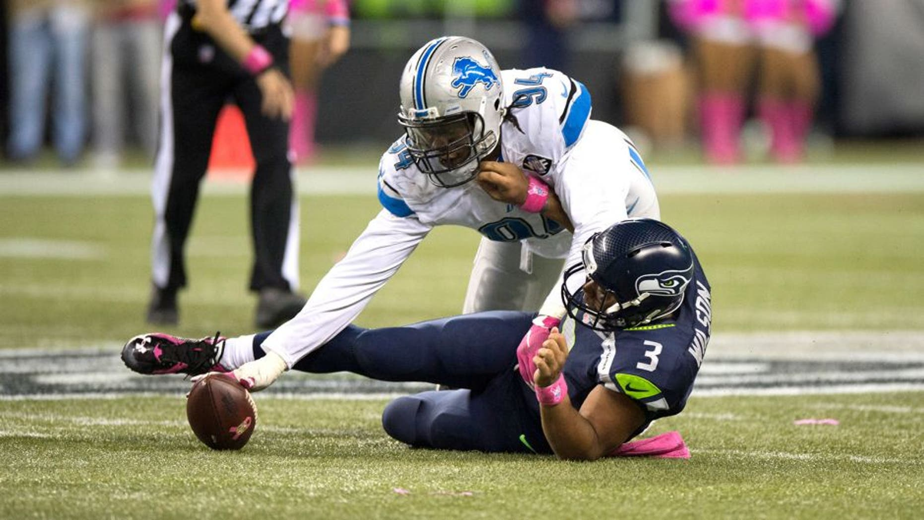 Oct 5, 2015; Seattle, WA, USA; Detroit Lions defensive end Ezekiel Ansah (94) recovers a fumble after sacking Seattle Seahawks quarterback Russell Wilson (3) during the fourth quarter at CenturyLink Field. The Seahawks won 13-10. Mandatory Credit: Troy Wayrynen-USA TODAY Sports