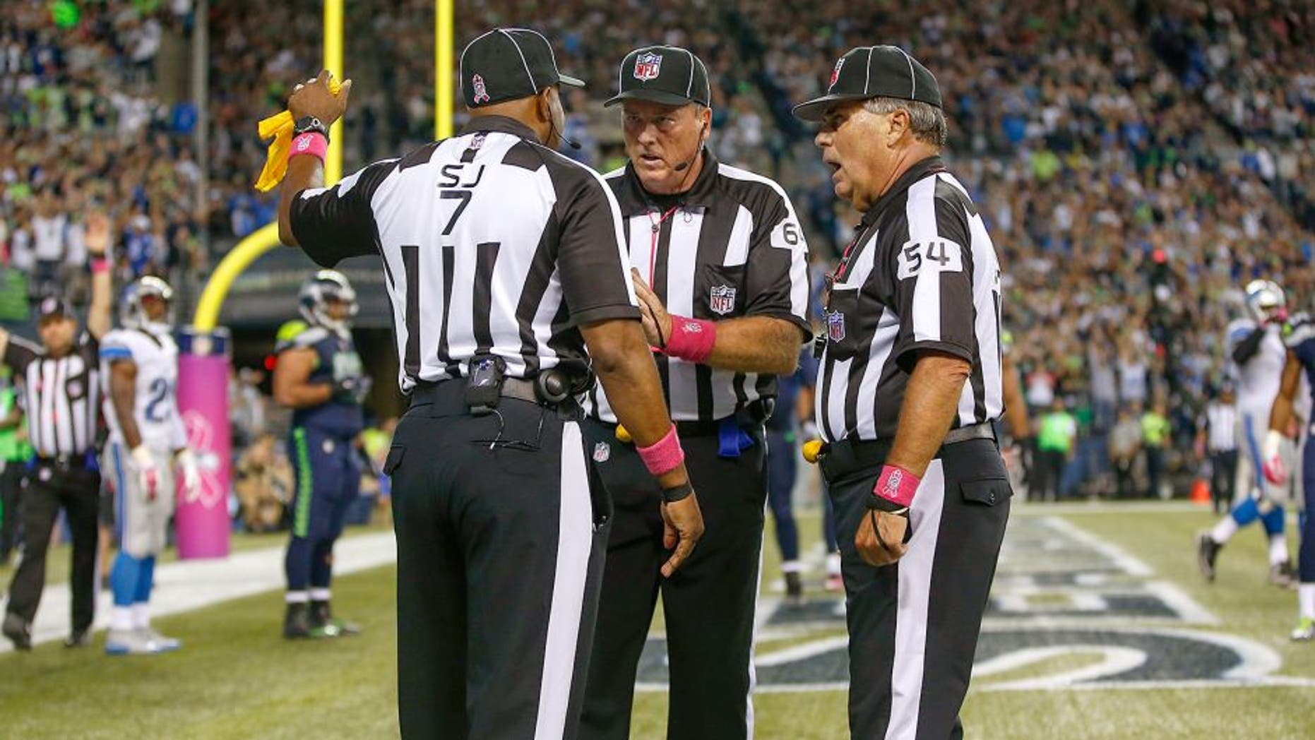 SEATTLE, WA - OCTOBER 05: Referees confer after the ball was batted out of the end zone by outside linebacker K.J. Wright of the Seattle Seahawks following a fumble by wide receiver Calvin Johnson of the Detroit Lions in the fourth quarter at CenturyLink Field on October 5, 2015 in Seattle, Washington. The Seahawks defeated the Lions 13-10. (Photo by Otto Greule Jr/Getty Images)