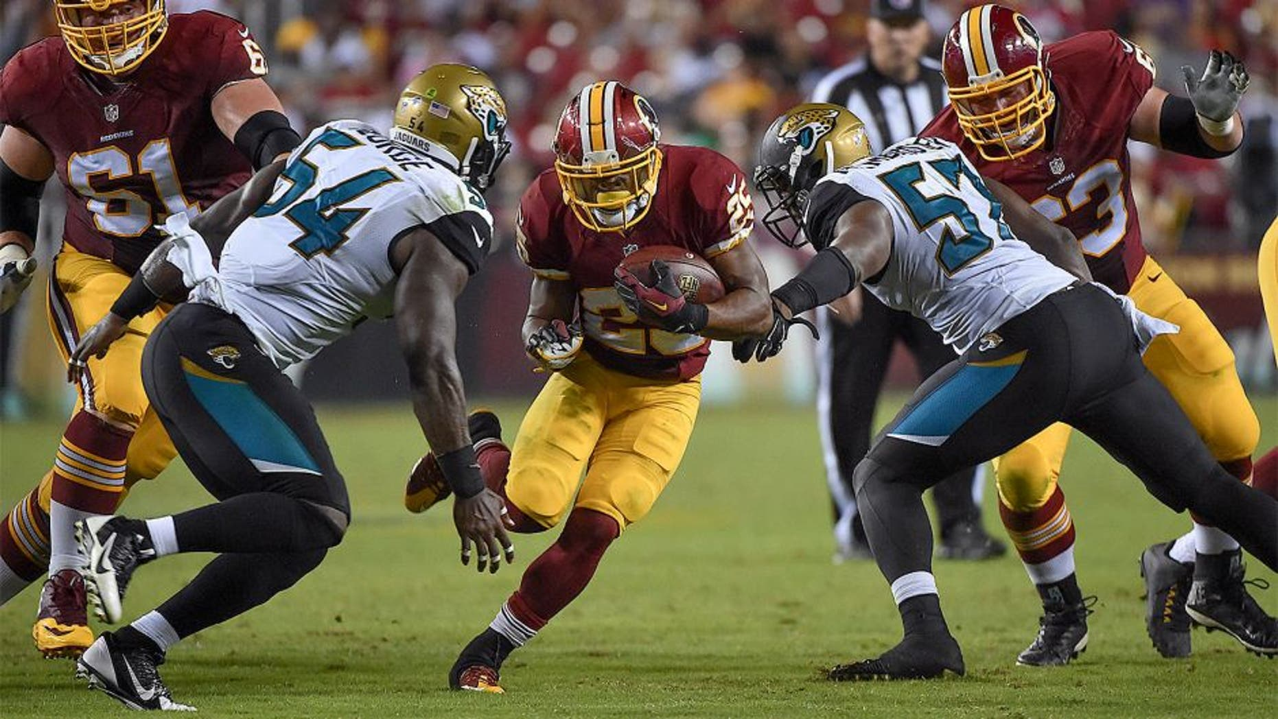 LANDOVER, MD - SEPTEMBER 3: Washington Redskins running back Chris Thompson (25) carries the ball for yardage during the fourth quarter in a NFL preseason game between the Washington Redskins and Jacksonville Jaguars at FedEx Field on September 3, 2015 in Landover, Md. (Photo by Ricky Carioti/The Washington Post via Getty Images)
