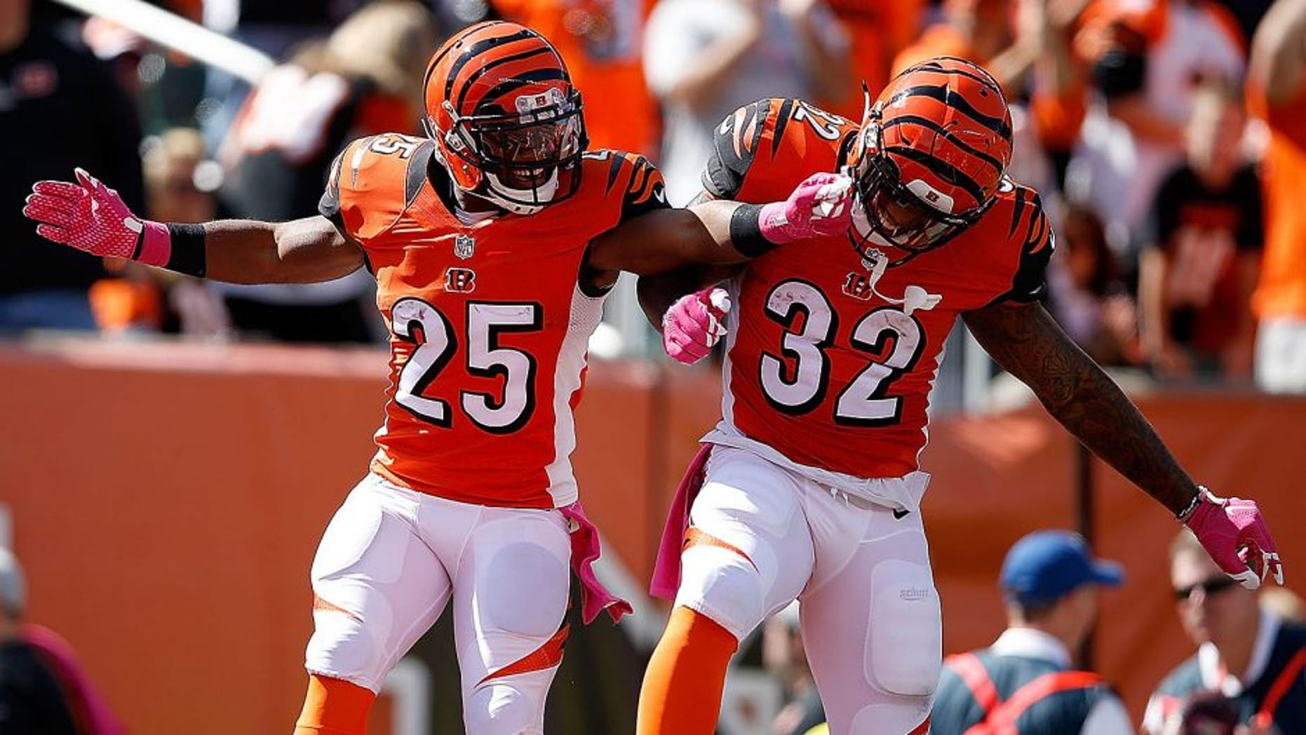 CINCINNATI, OH - OCTOBER 4: Giovani Bernard #25 of the Cincinnati Bengals is congratulated by Jeremy Hill #32 of the Cincinnati Bengals after scoring a touchdown during the first quarter of the game against the Kansas City Chiefs at Paul Brown Stadium on October 4, 2015 in Cincinnati, Ohio. (Photo by Joe Robbins/Getty Images)