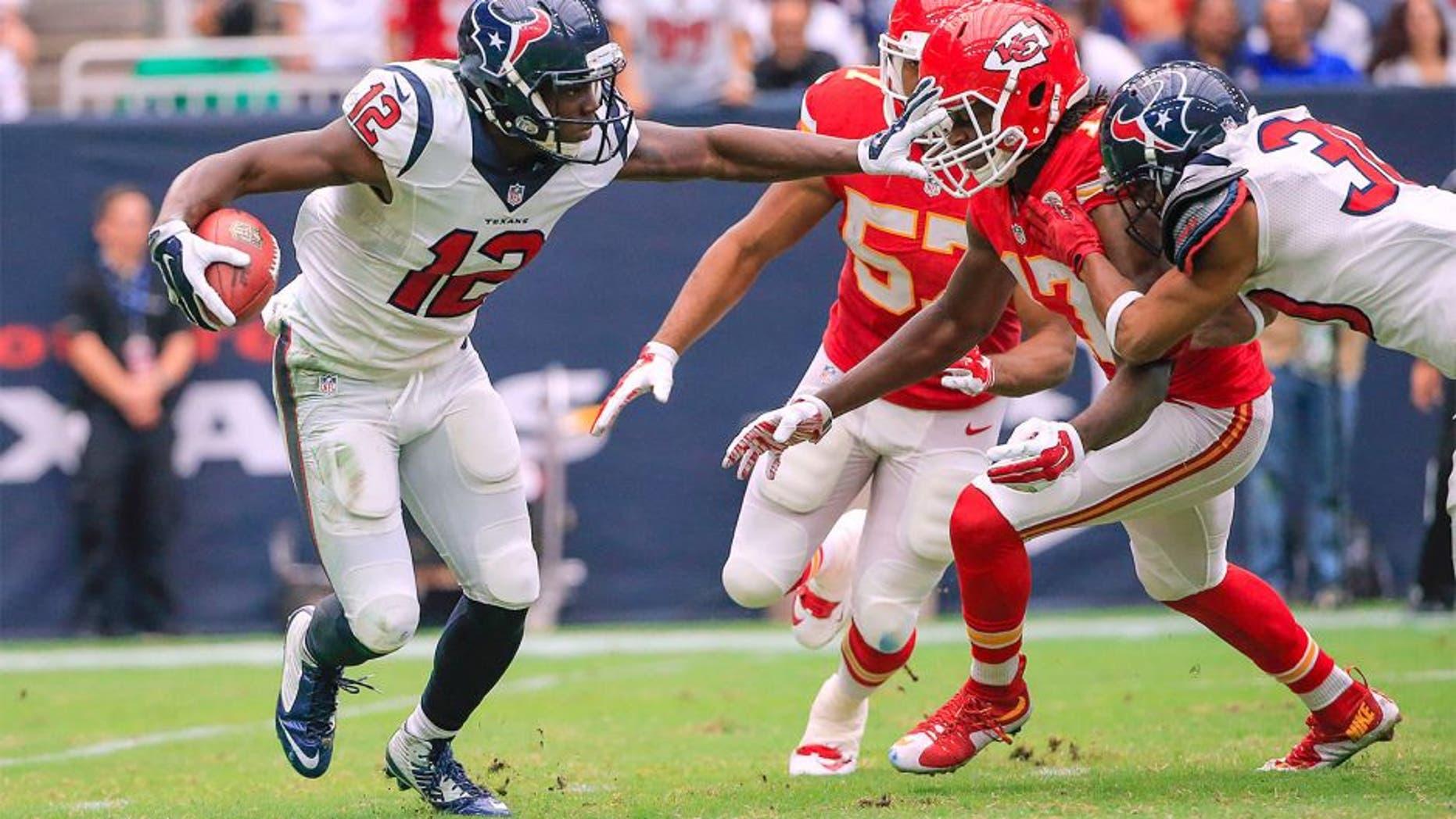 Sep 13, 2015; Houston, TX, USA; Houston Texans wide receiver Keith Mumphery (12) stiff arms Kansas City Chiefs wide receiver Chris Conley (17) during the game at NRG Stadium. Mandatory Credit: Kevin Jairaj-USA TODAY Sports