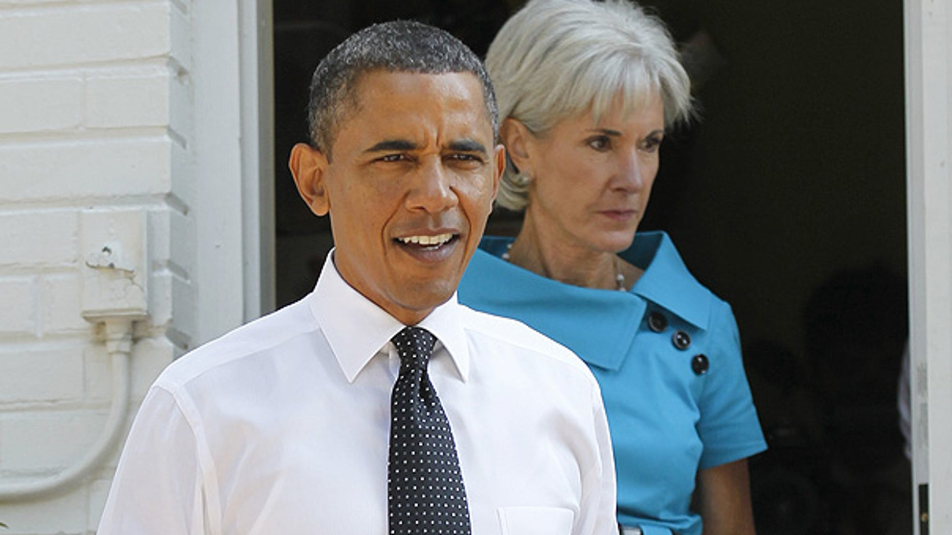 Sept. 22: President Obama, accompanied by Health and Human Services Secretary Kathleen Sebelius, arrives in the backyard of a private residence in Falls Church, Va.