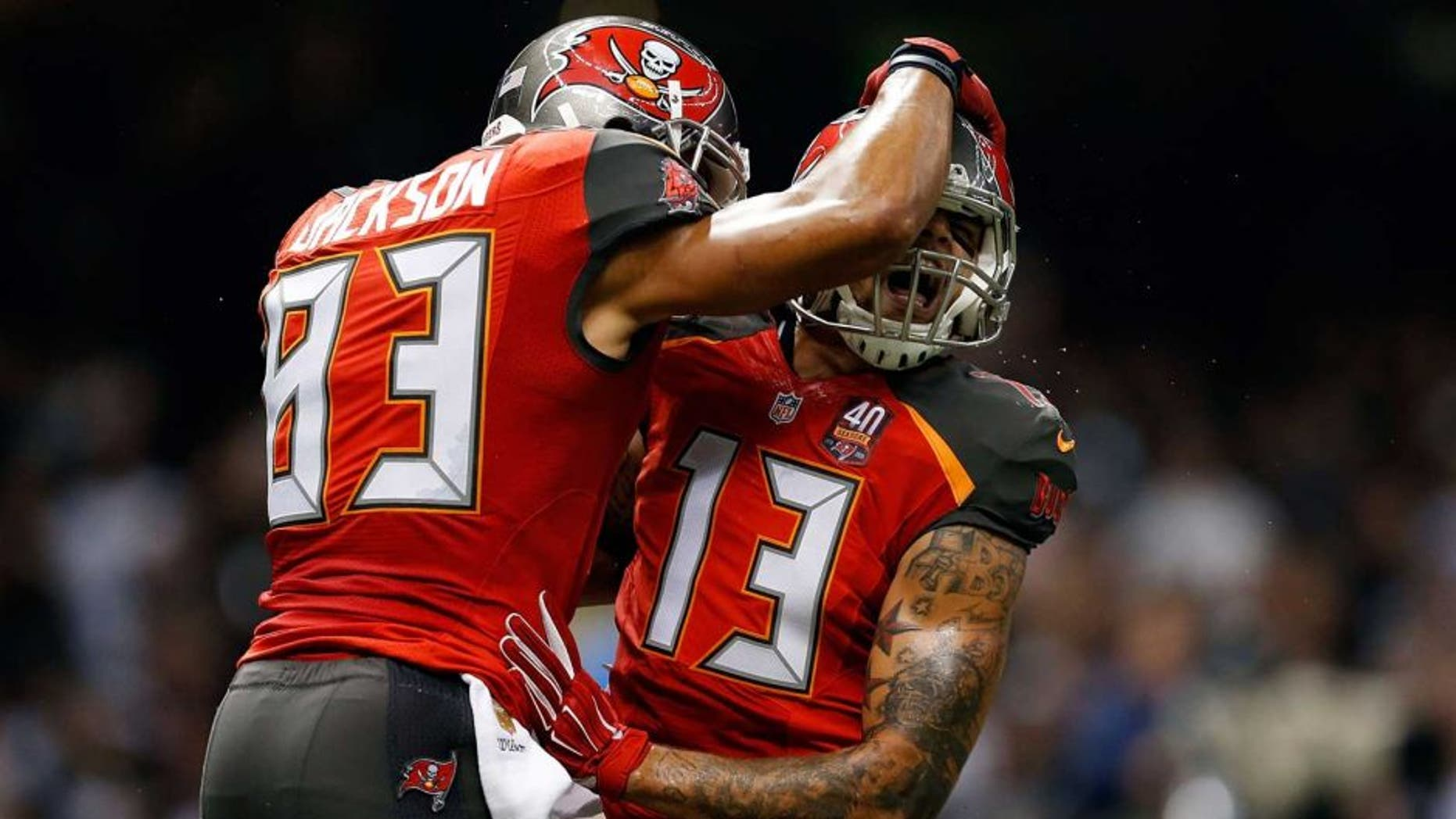 NEW ORLEANS, LA - SEPTEMBER 20: Mike Evans #13 celebrates with Vincent Jackson #83 of the Tampa Bay Buccaneers following his touchdown reception during the second quarter of a game against the New Orleans Saints at the Mercedes-Benz Superdome on September 20, 2015 in New Orleans, Louisiana. (Photo by Wesley Hitt/Getty Images)