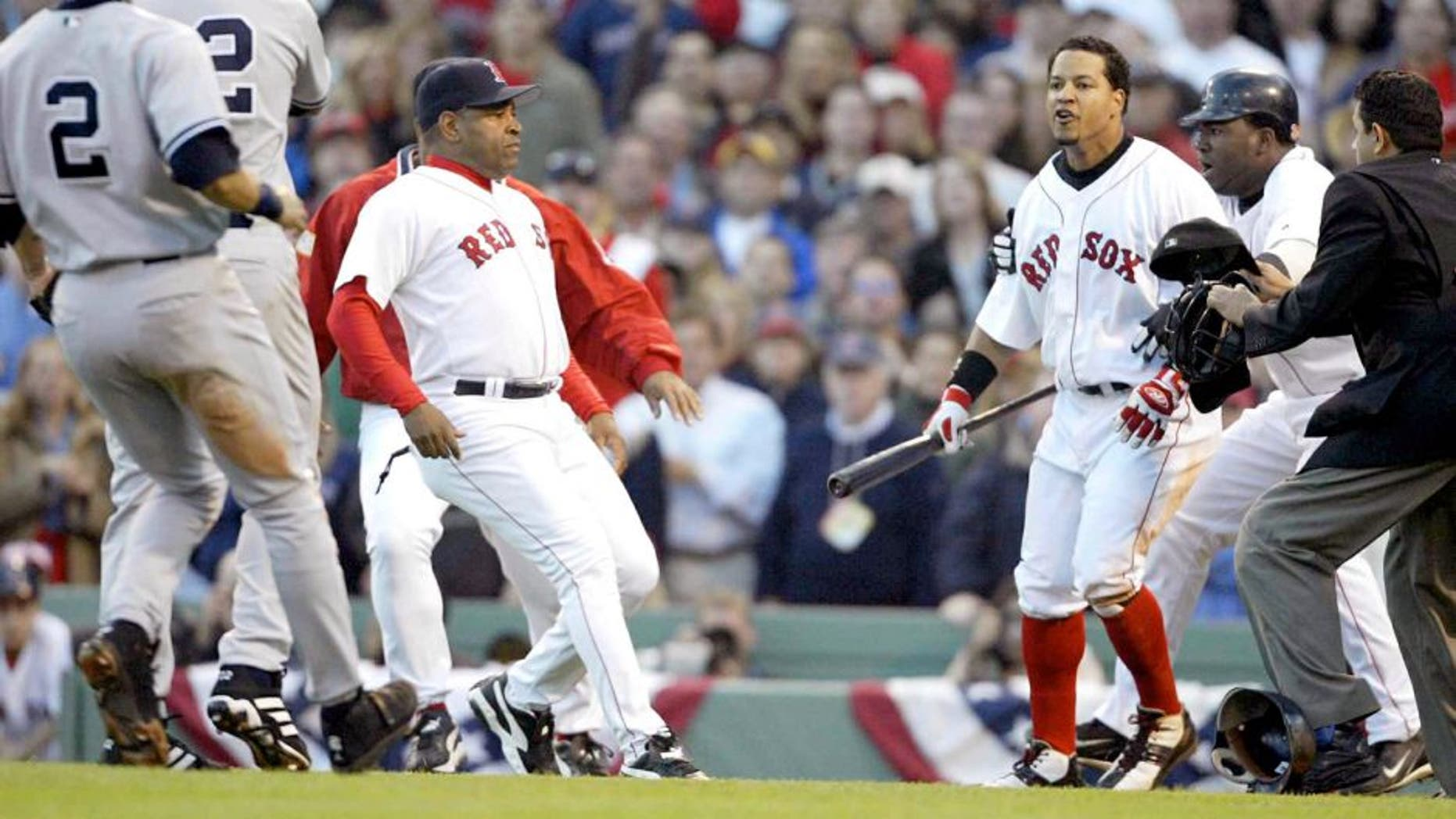 BOSTON - OCTOBER 11: Manny Ramirez #24 of the Boston Red Sox reacts after a pitch by Roger Clemens #22 of the New York Yankees during the fourth inning of Game 3 of the 2003 American League Championship Series on October 11, 2003 at Fenway Park in Boston, Massachusettes. (Photo by Jed Jacobsohn/Getty Images)