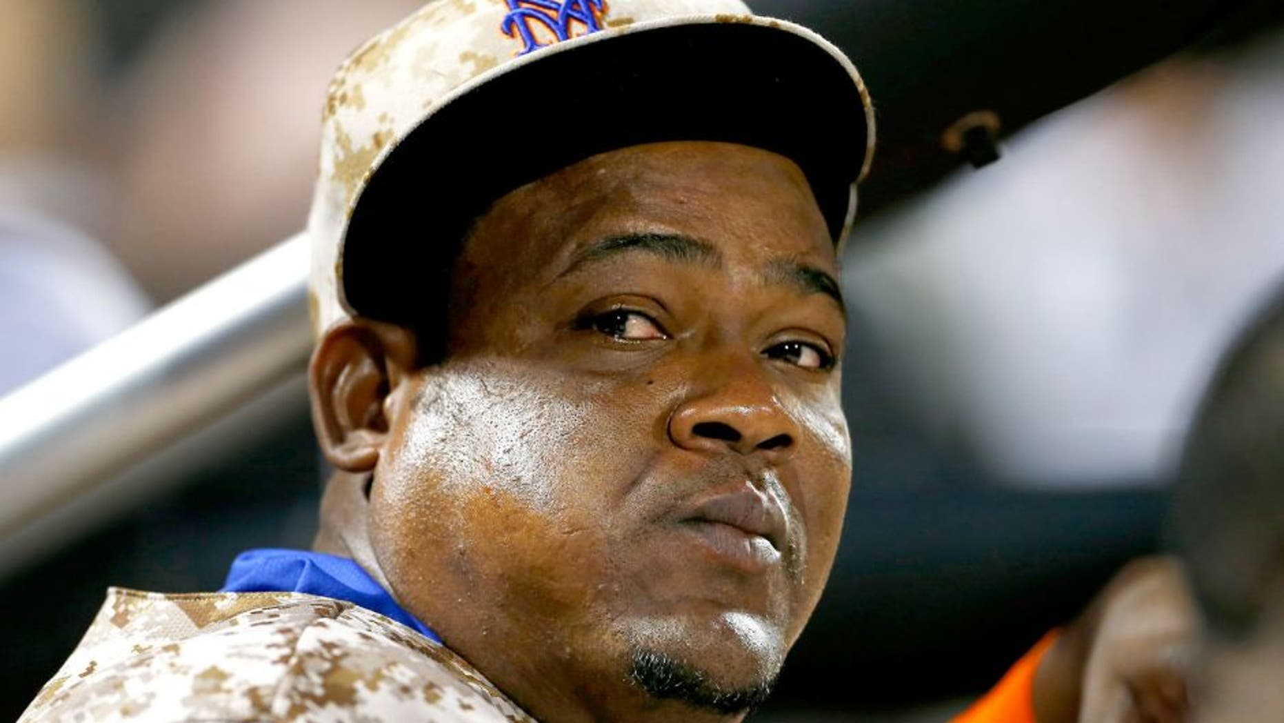 NEW YORK, NY - AUGUST 31: Juan Uribe #2 of the New York Mets looks on from the dugout against the Philadelphia Phillies on August 31, 2015 at Citi Field in the Flushing neighborhood of the Queens borough of New York City. (Photo by Rich Schultz/Getty Images)