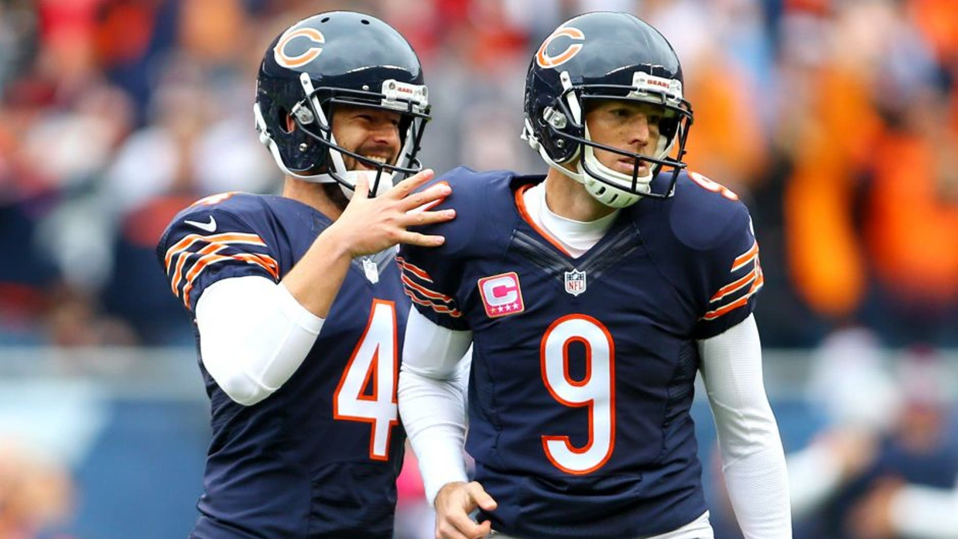 Oct 4, 2015; Chicago, IL, USA; Chicago Bears kicker Robbie Gould (9) celebrates with punter Spencer Lanning (4) ater kicking the winning field goal against the Oakland Raiders in the fourth quarter at Soldier Field. Mandatory Credit: Jerry Lai-USA TODAY Sports