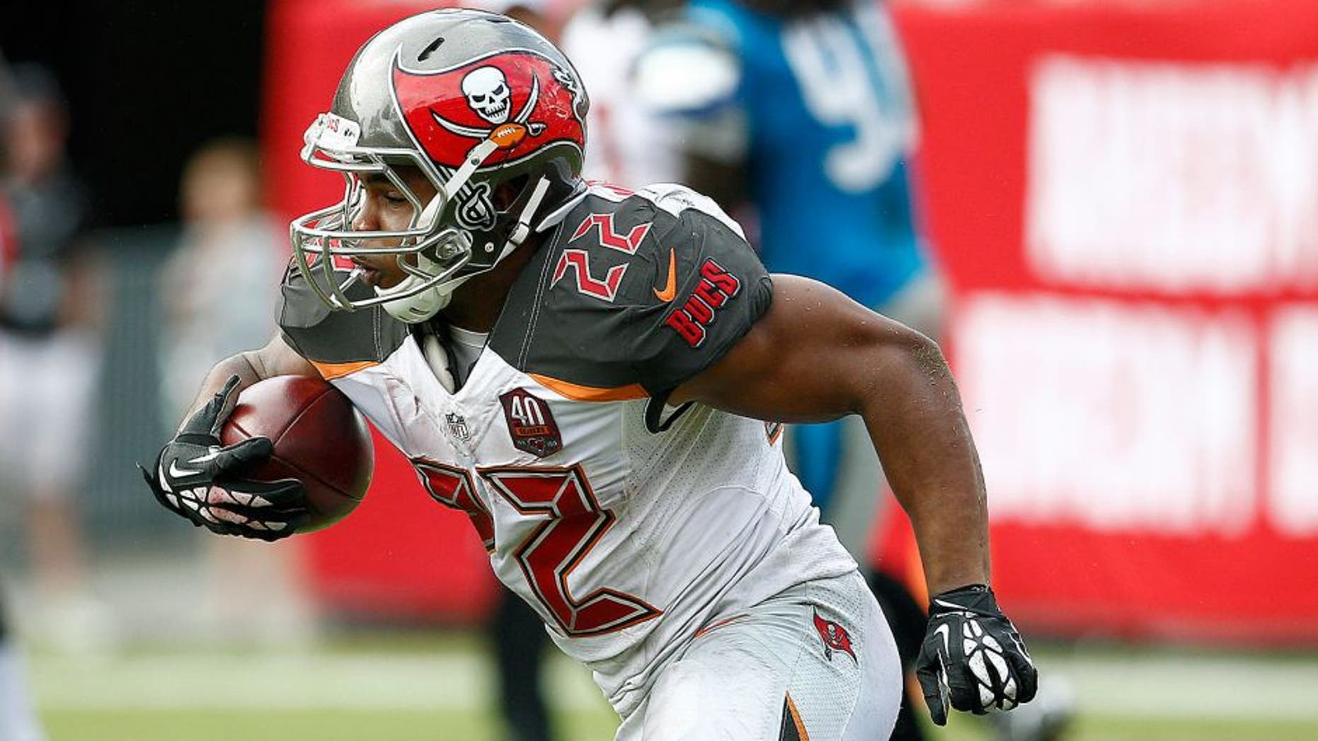 Oct 4, 2015; Tampa, FL, USA; Tampa Bay Buccaneers running back Doug Martin (22) runs for a first down during the fourth quarter of an NFL football game against the Carolina Panthers at Raymond James Stadium. Carolina won 37-23. Mandatory Credit: Reinhold Matay-USA TODAY Sports