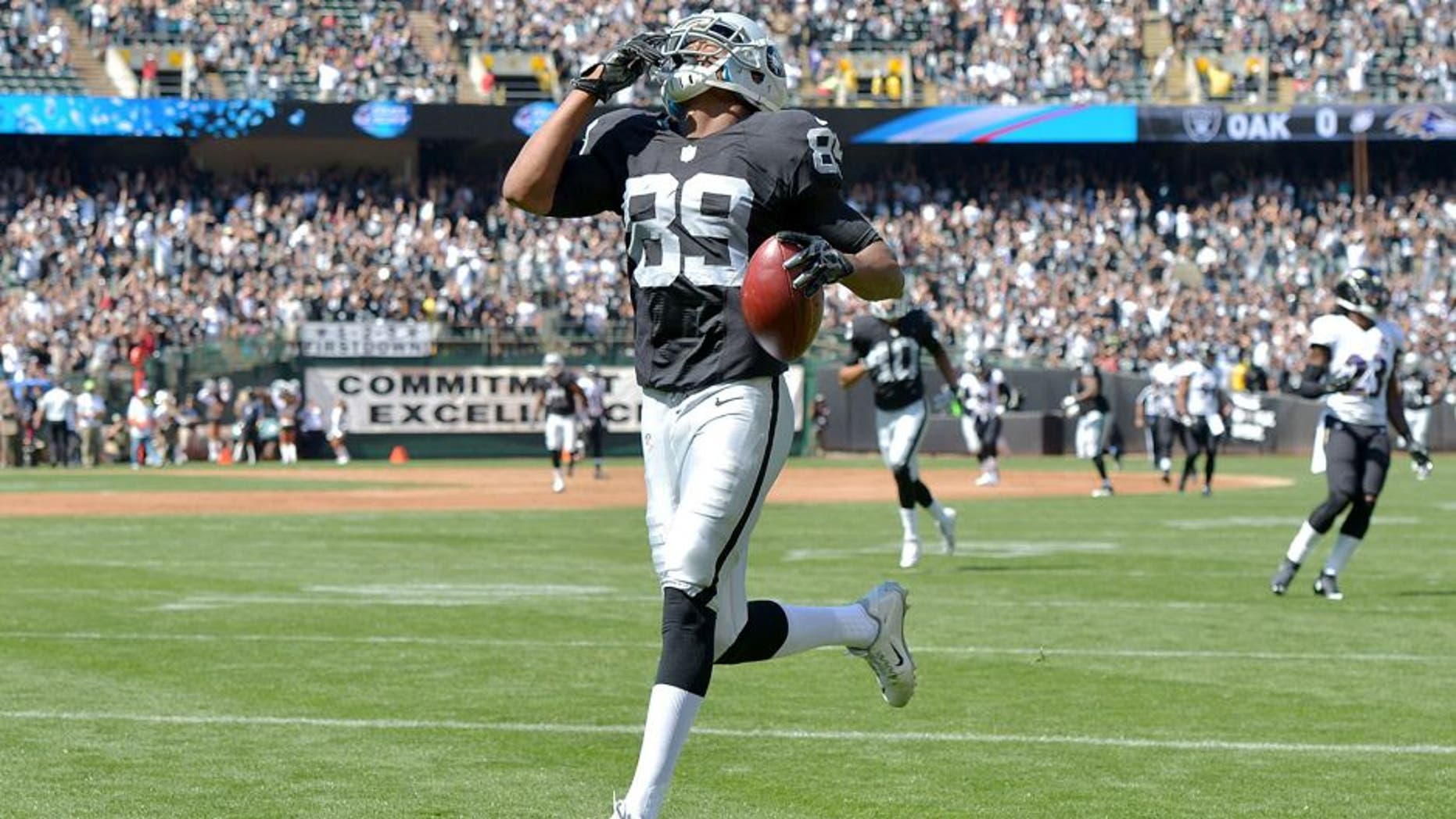 Sep 20, 2015; Oakland, CA, USA; Oakland Raiders receiver Amari Cooper (89) reacts after scoring on a 68-yard touchdown reception in the first quarter against the Baltimore Ravens as at O.co Coliseum. Mandatory Credit: Kirby Lee-USA TODAY Sports
