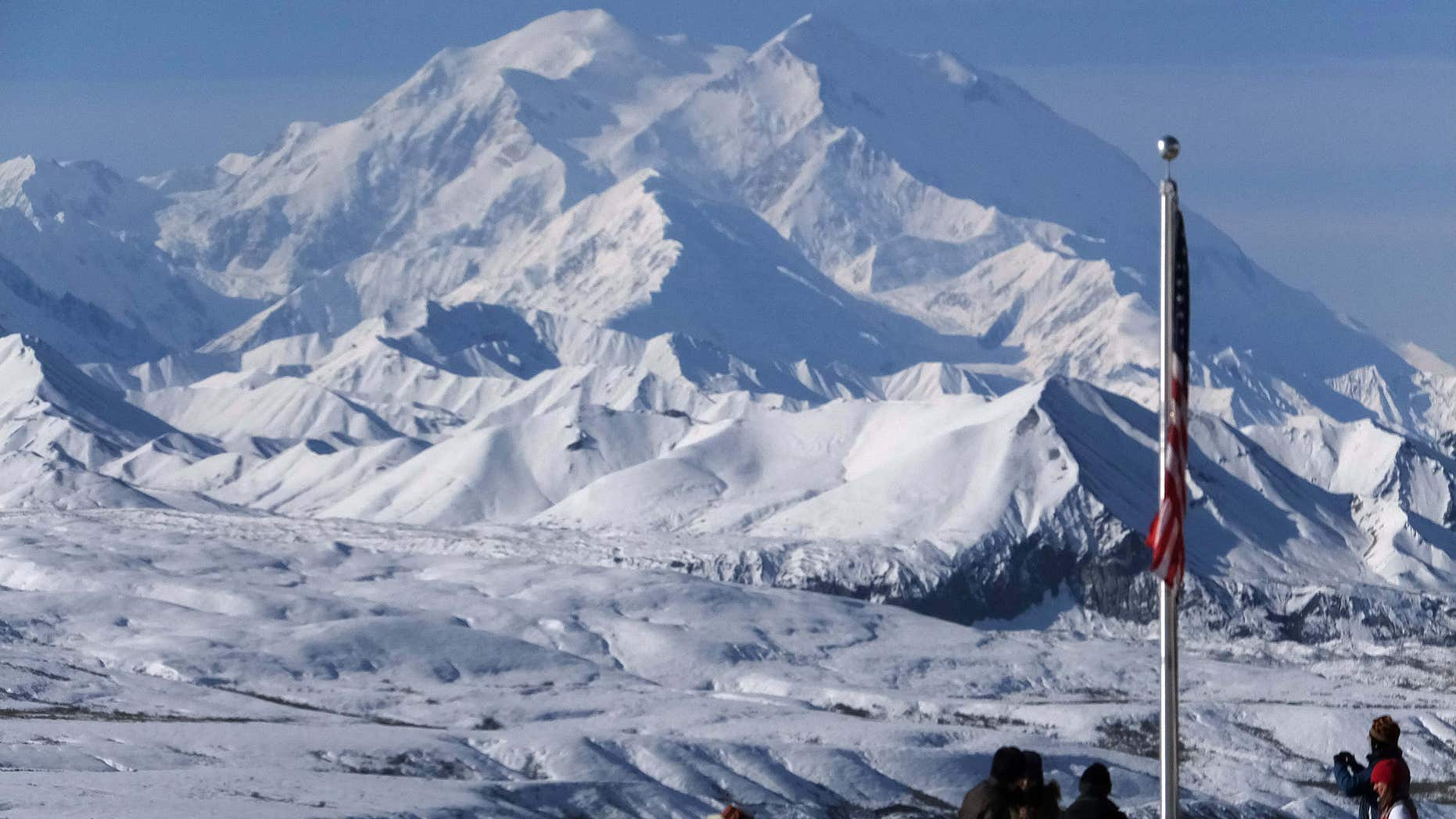 Sept. 2, 2015: People stand at the Eielson Visitor Center with a view of North America's tallest peak, Denali, in the background.