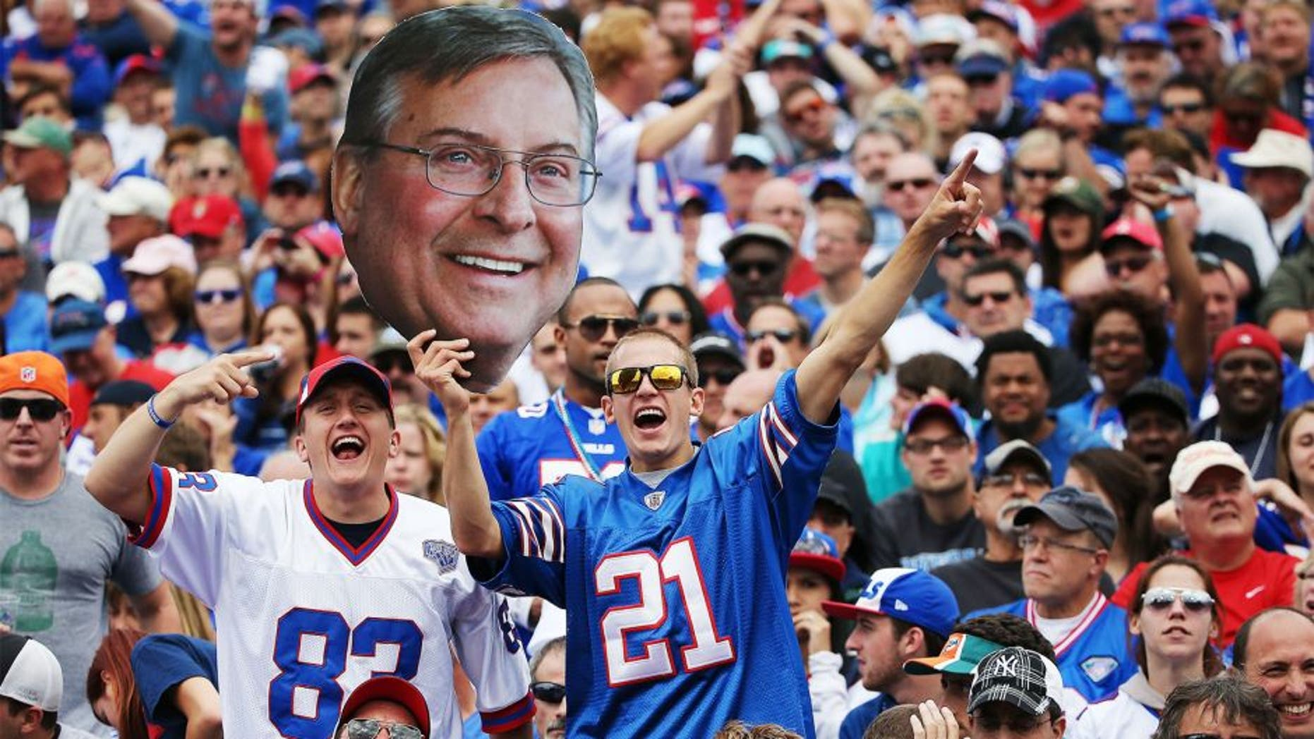 ORCHARD PARK, NY - SEPTEMBER 14: Buffalo Bills fans hold up a picture of Terry Pegula during the first half against the Miami Dolphins at Ralph Wilson Stadium on September 14, 2014 in Orchard Park, New York. (Photo by Tom Szczerbowski/Getty Images)