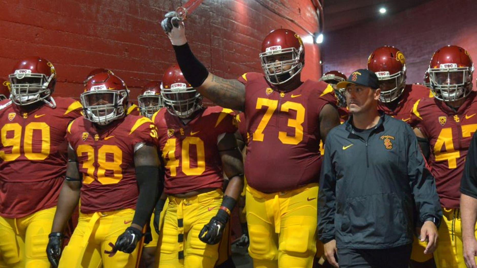 Oct 8, 2015; Los Angeles, CA, USA; Southern California Trojans coach Steve Sarkisian accompanies players onto the field before the game against the Washington Huskies at Los Angeles Memorial Coliseum. Mandatory Credit: Kirby Lee-USA TODAY Sports