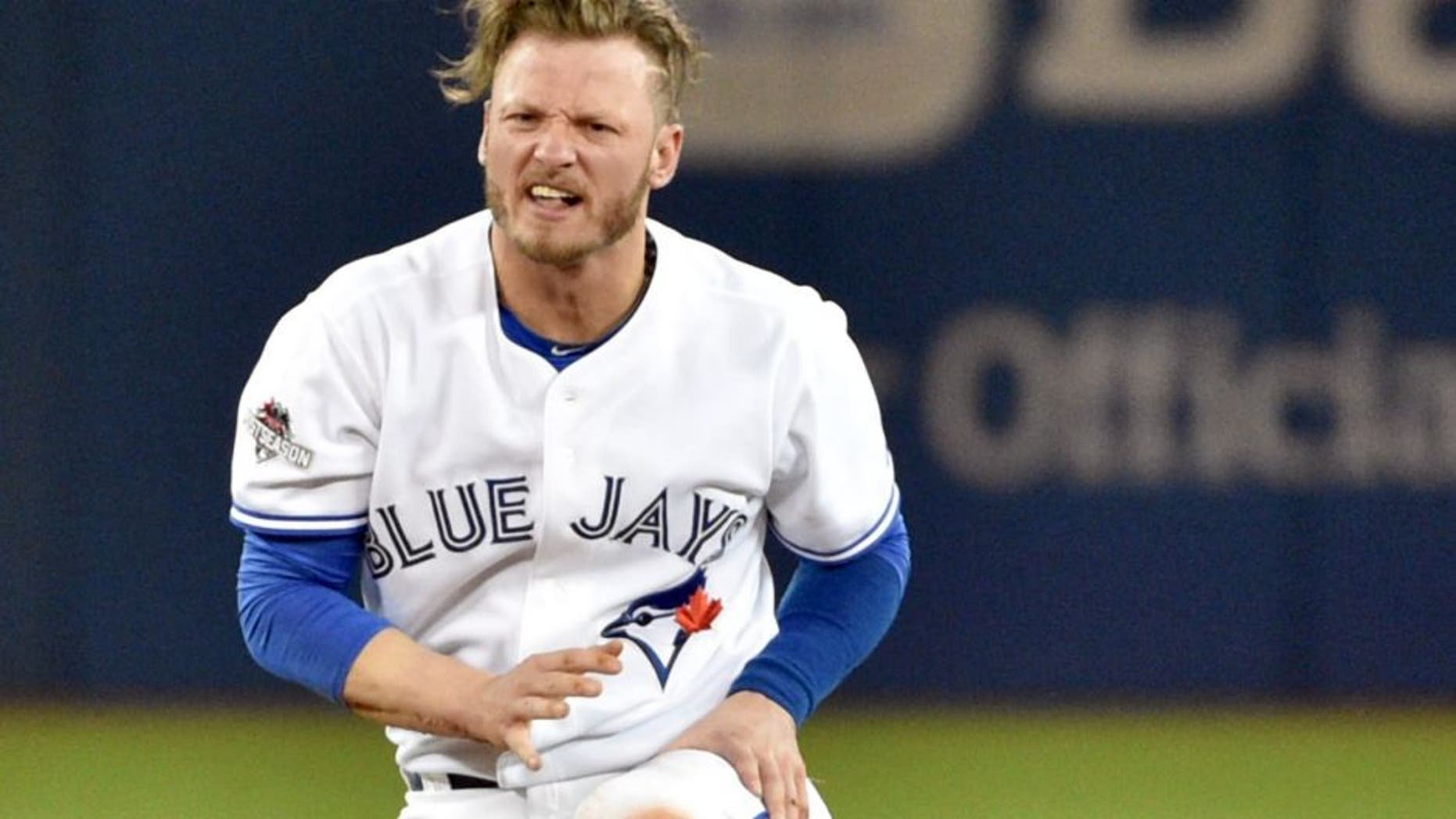 Oct 8, 2015; Toronto, Ontario, CAN; Toronto Blue Jays third baseman Josh Donaldson reacts after being forced out at second base by the Texas Rangers in the fourth inning in game one of the ALDS at Rogers Centre. Mandatory Credit: Nick Turchiaro-USA TODAY Sports