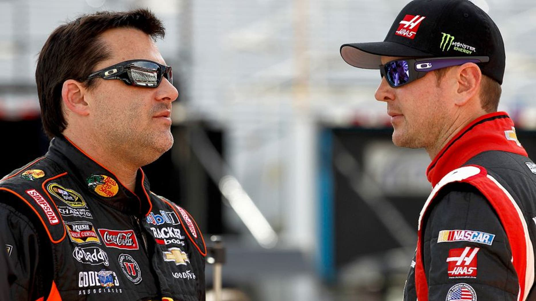 BRISTOL, TN - MARCH 14: Tony Stewart, driver of the #14 Bass Pro Shops / Mobil 1 Chevrolet, talks with Kurt Busch, driver of the #41 Haas Automation Chevrolet, on the grid during qualifying for the NASCAR Sprint Cup Series Food City 500 at Bristol Motor Speedway on March 14, 2014 in Bristol, Tennessee. (Photo by Jeff Zelevansky/NASCAR via Getty Images)