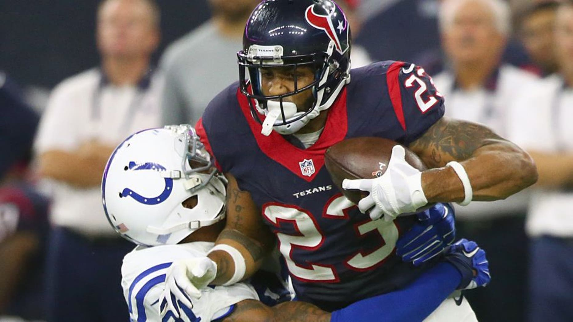 HOUSTON, TX - OCTOBER 08: Arian Foster #23 of the Houston Texans is tackled by Jonathan Newsome #91 of the Indianapolis Colts in the first quarter on October 8, 2015 at NRG Stadium in Houston, Texas. (Photo by Ronald Martinez/Getty Images)